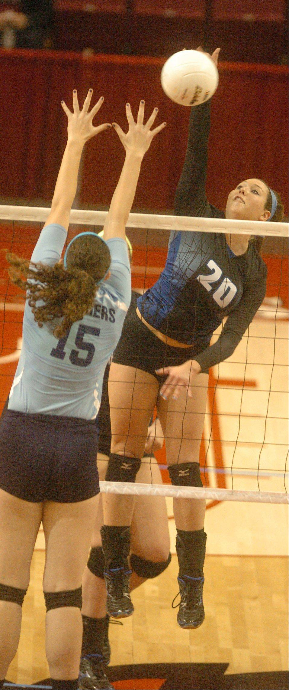 Michelle McLaughlin of St. Francis goes up for a hit during the class 3A state semifinal between St. Francis and Champaign Centennial in Bloomington-Normal Friday. Lauren Cloyd of Centennial was trying to block her shot.