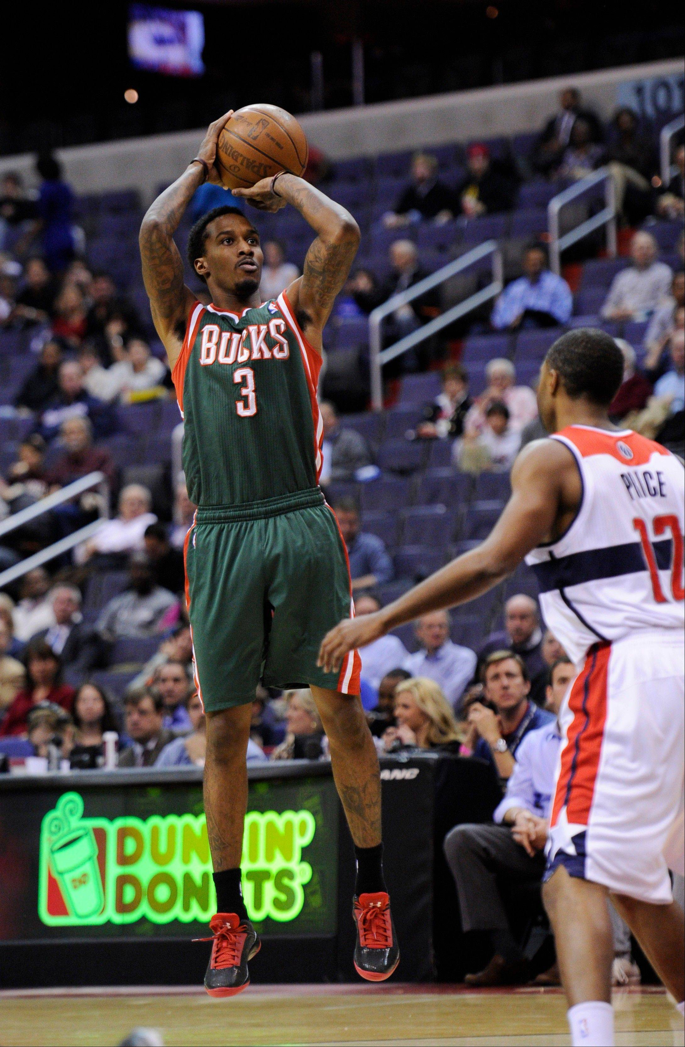 Milwaukee Bucks guard Brandon Jennings shoots against Washington Wizards guard A.J. Price Friday during the first half in Washington.