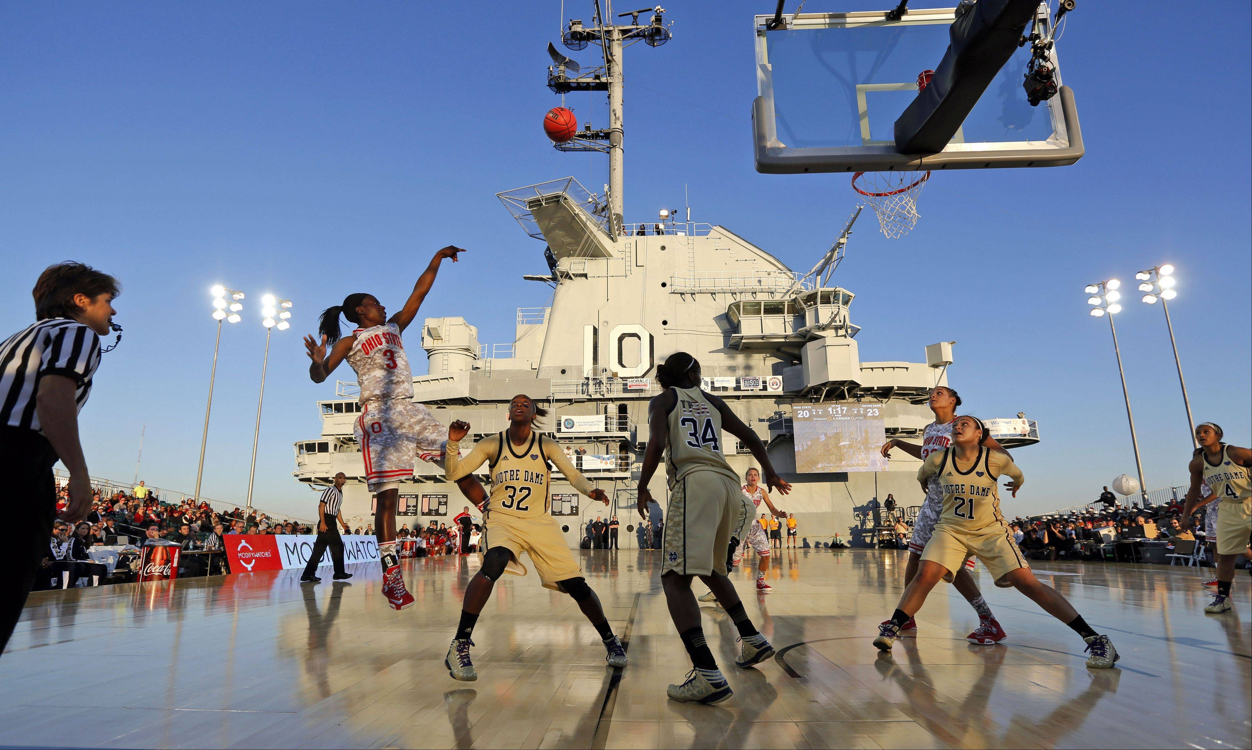 Ohio State's Amber Stokes shoots over Notre Dames's Jewell Loyd Friday during the first half of the Carrier Classic onboard the USS Yorktown in Mount Pleasant, S.C.