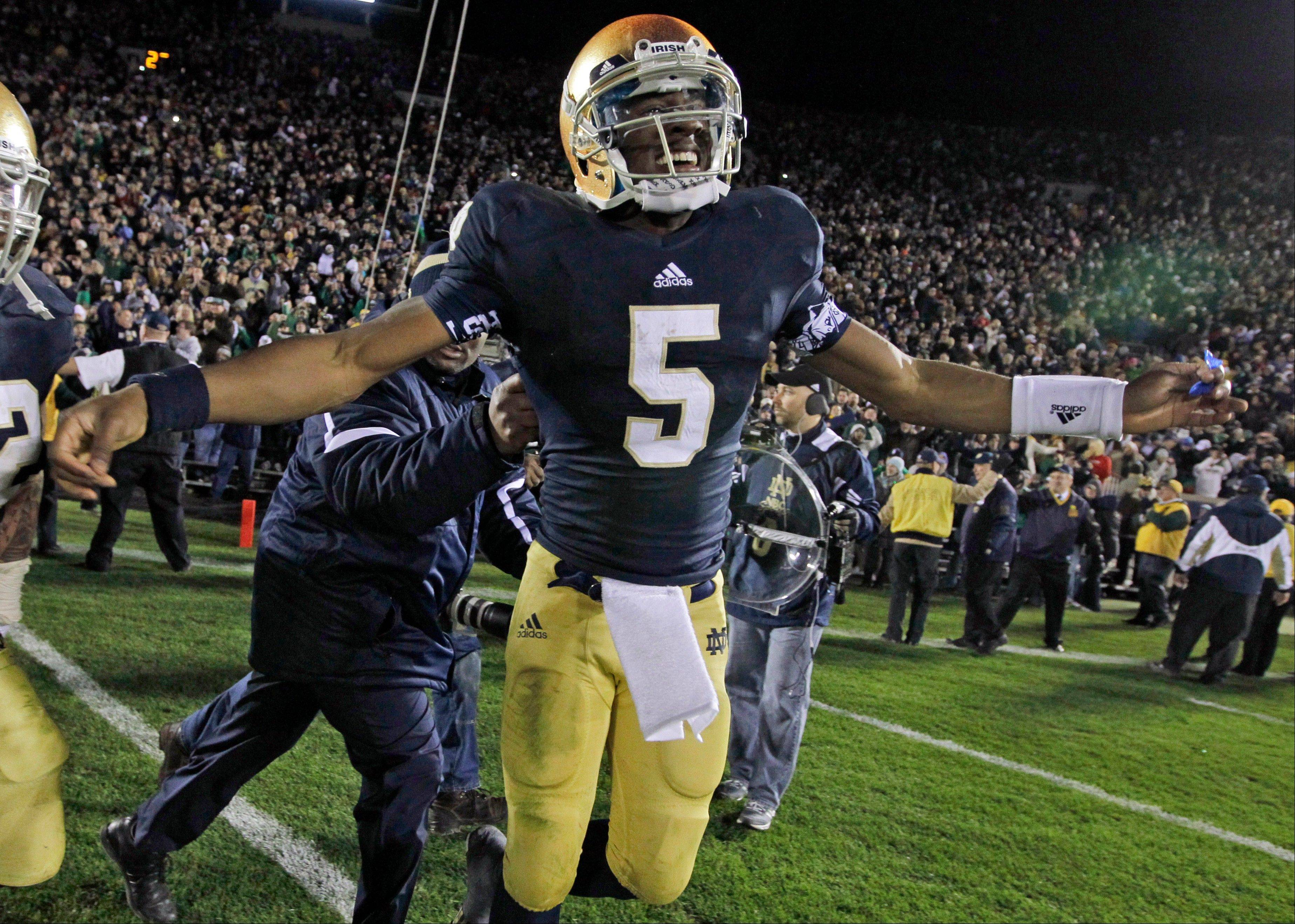Notre Dame quarterback Everett Golson celebrates Saturday after scoring the winning touchdown in the the third overtime period against Pittsburgh in South Bend. The Irish take on 2-7 Boston College Saturday.
