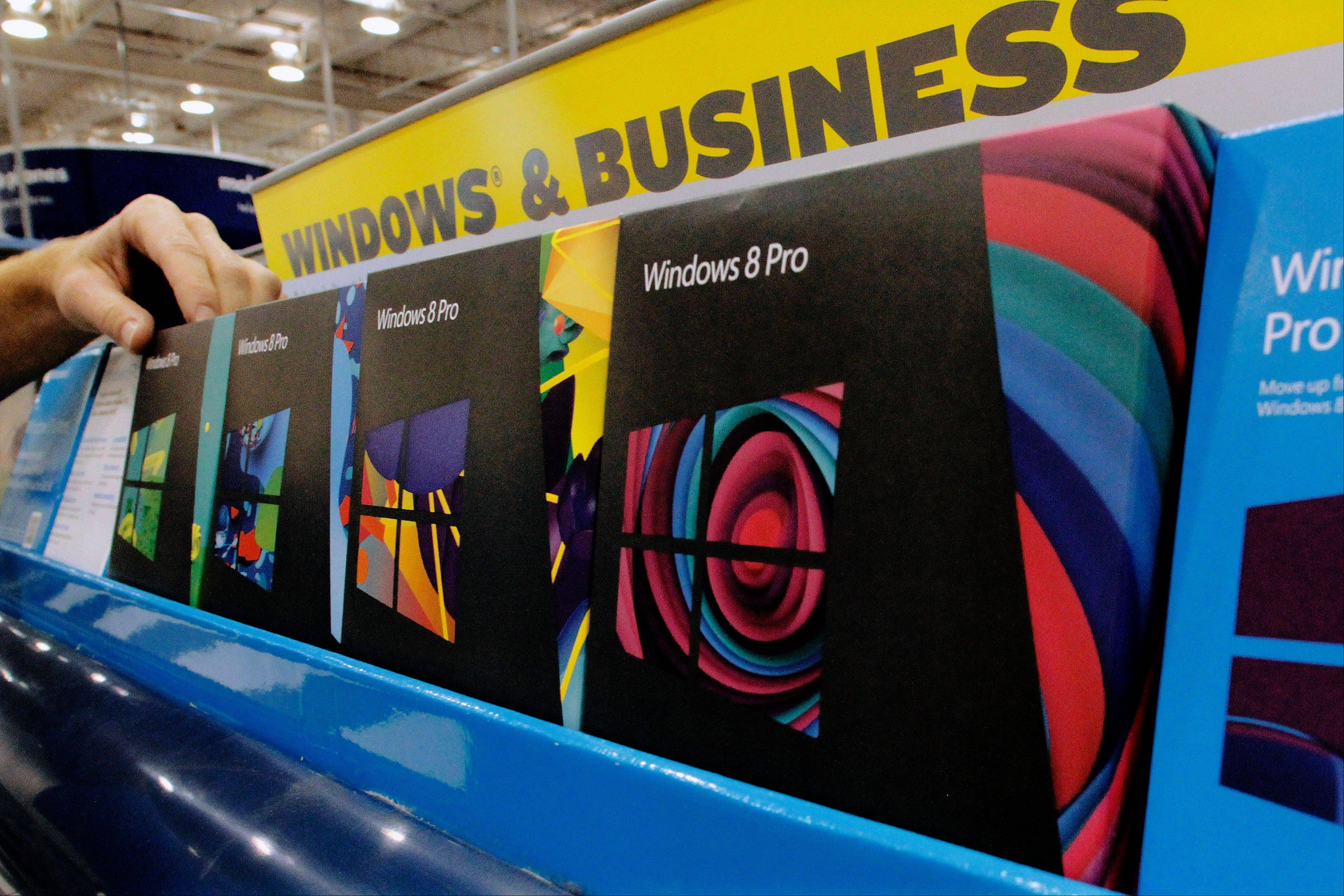 Different versions of the Microsoft Windows 8 operating system displayed during a media availability at Best Buy in Springfield.