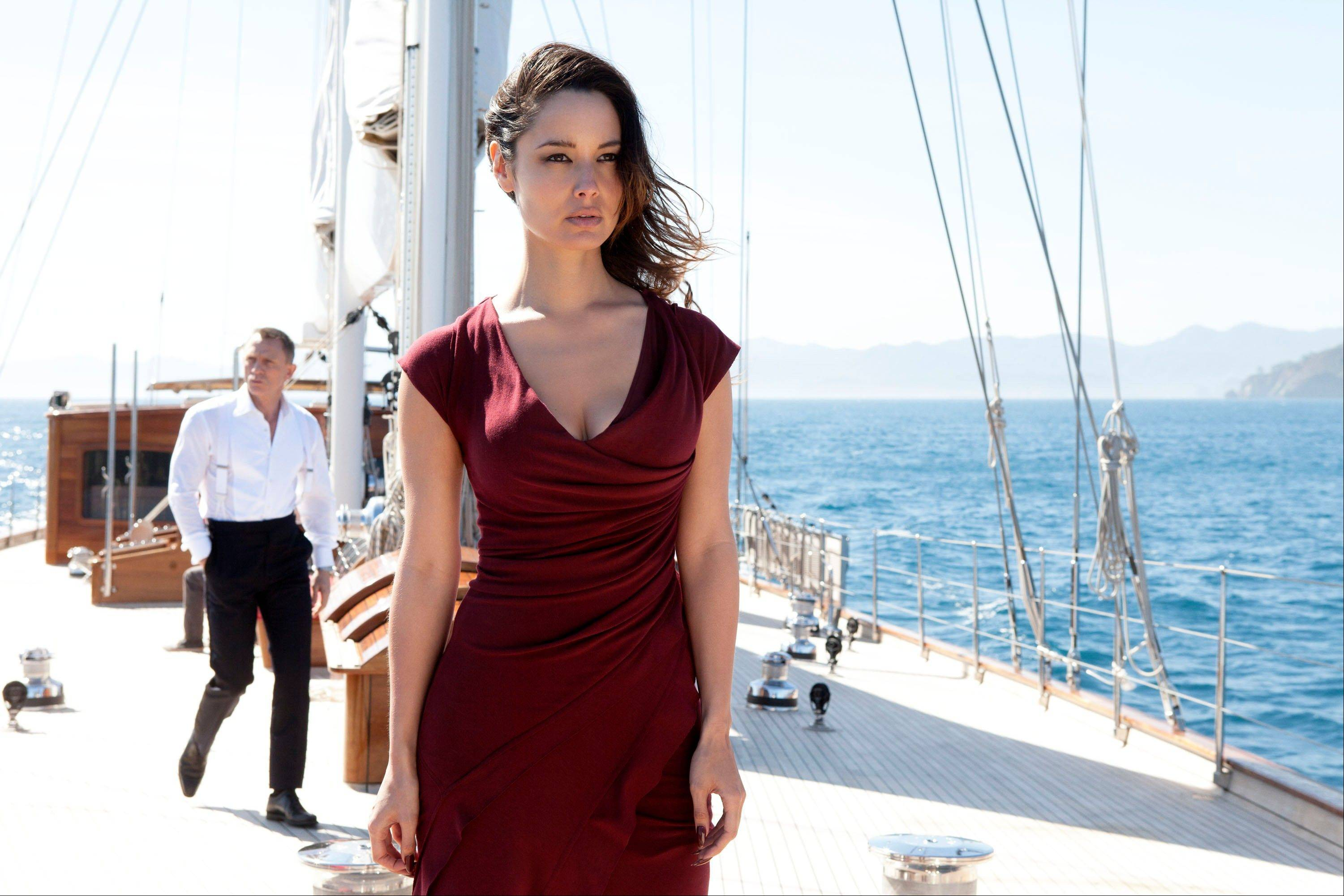 This film image released by Sony Pictures shows Berenice Marlohe in a scene from the film �Skyfall.� Costume designer Jany Temime says her mantra for the entire wardrobe of �Skyfall,� which opens Friday, was �iconic for 2012.� For Marlohe, Temime envisioned an Ava Gardner type. She required two knockout gowns, one a second-skin L�Wren Scott number that Marlohe had to be sewn into each morning, and a red, slinky Donna Karan.