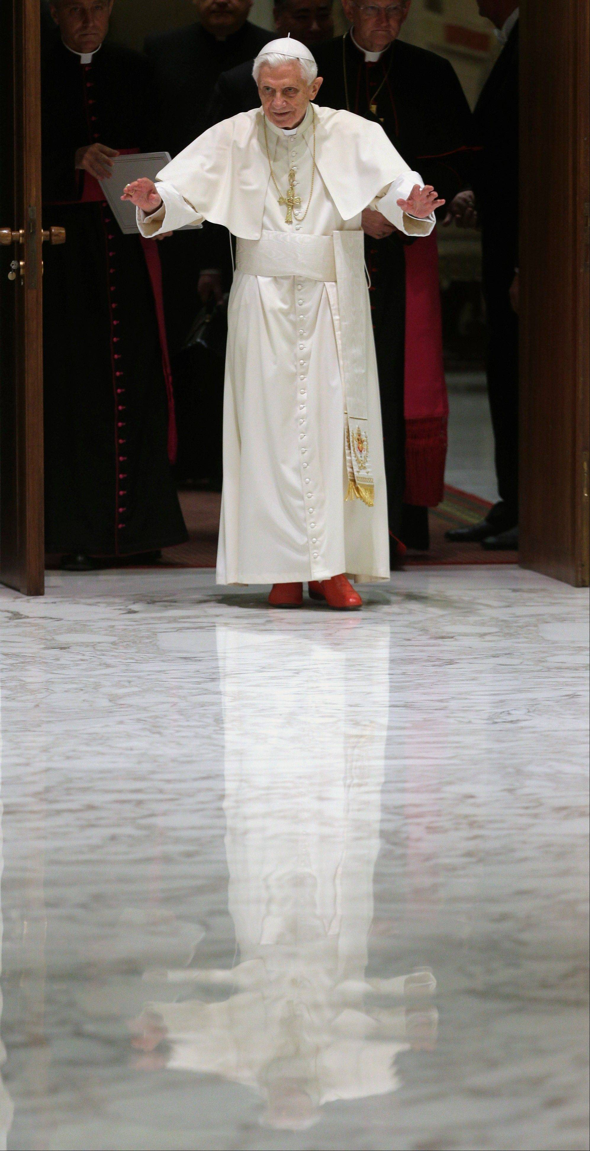 Pope Benedict XVI waves Saturday upon his arrival for a meeting with the �Santa Cecilia� association, at the Vatican