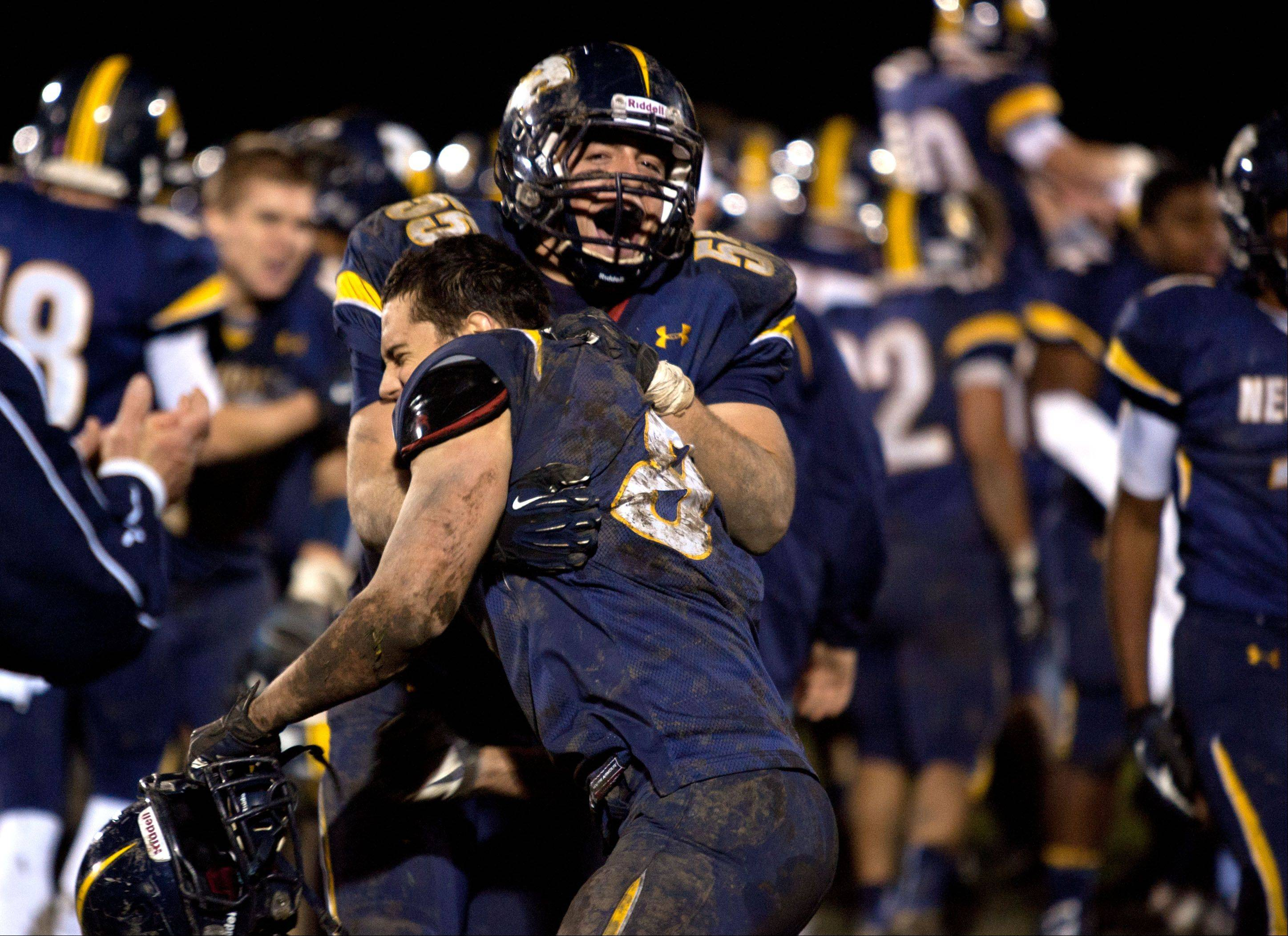 Neuqua Valley�s Michael Casas, 55, and John Moore, 8, celebrate Saturday�s win over Waubonsie Valley.