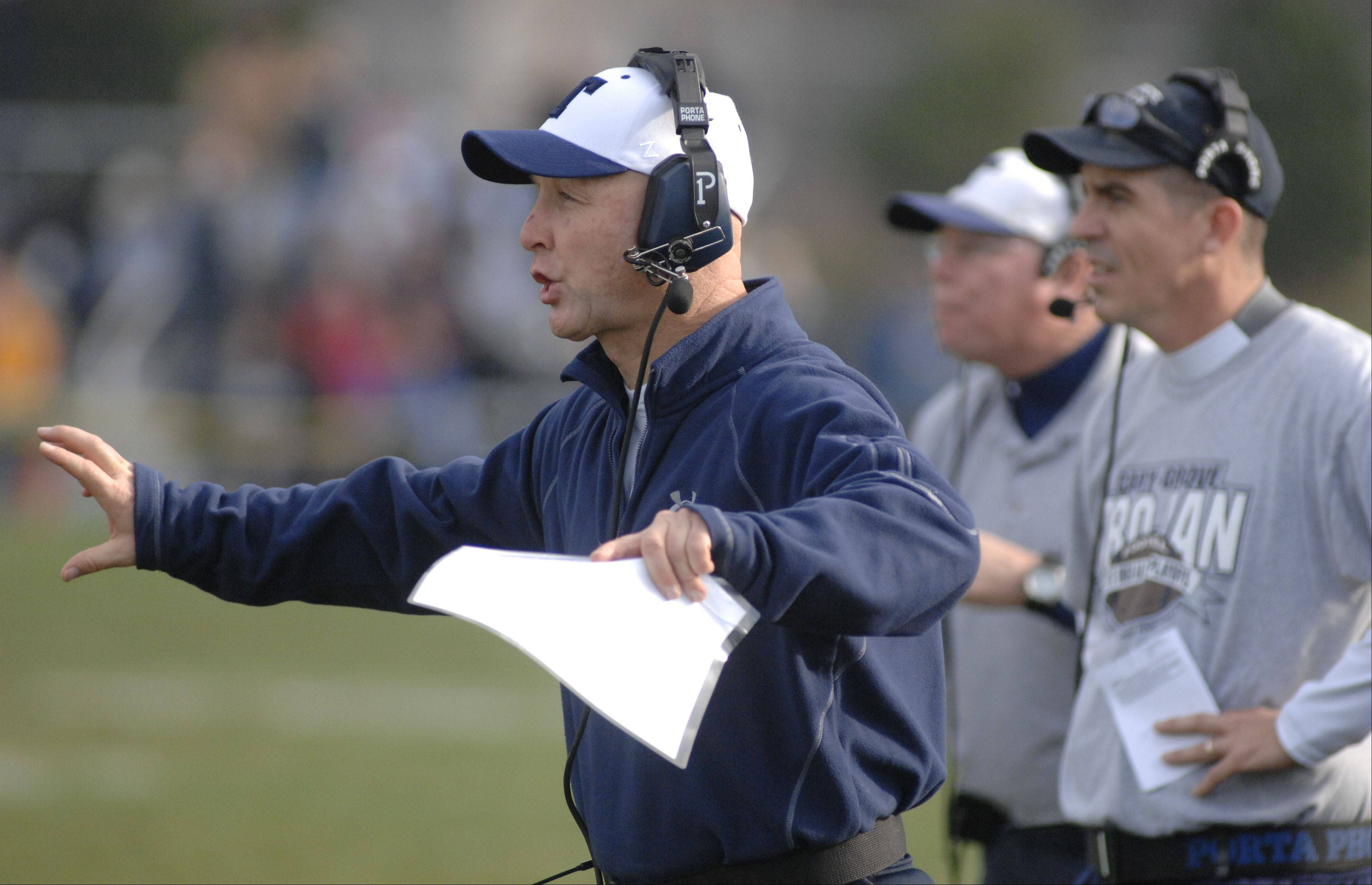Cary-Grove defensive coordinator Don Sutherland directs his troops during the Trojans� 7-0 Class 6A quarterfinal win over Crystal Lake Central Saturday.