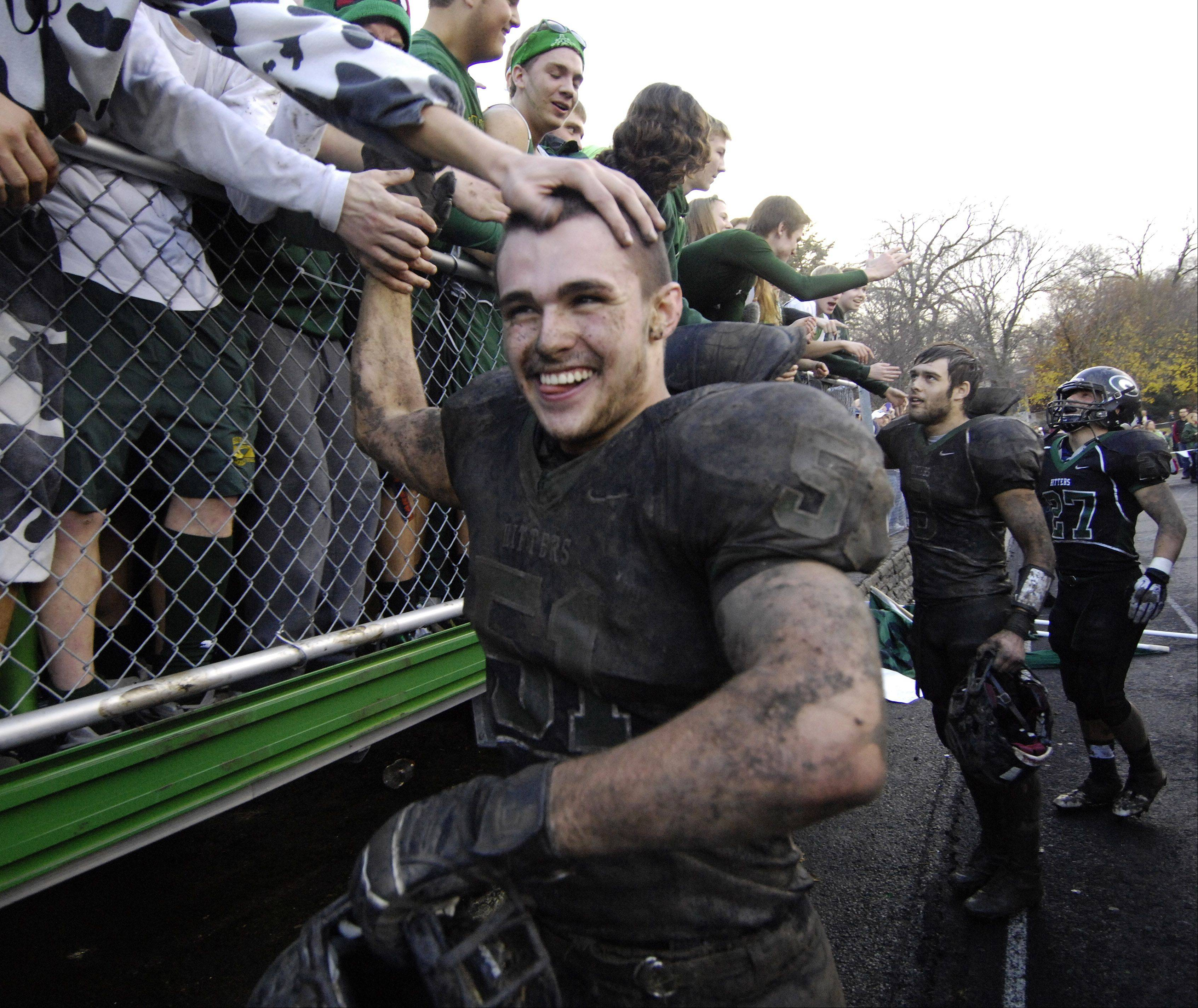 Glenbard West�s Nick Garland receives congratulations from fans following Saturday�s 3-0 victory over Wheaton North.