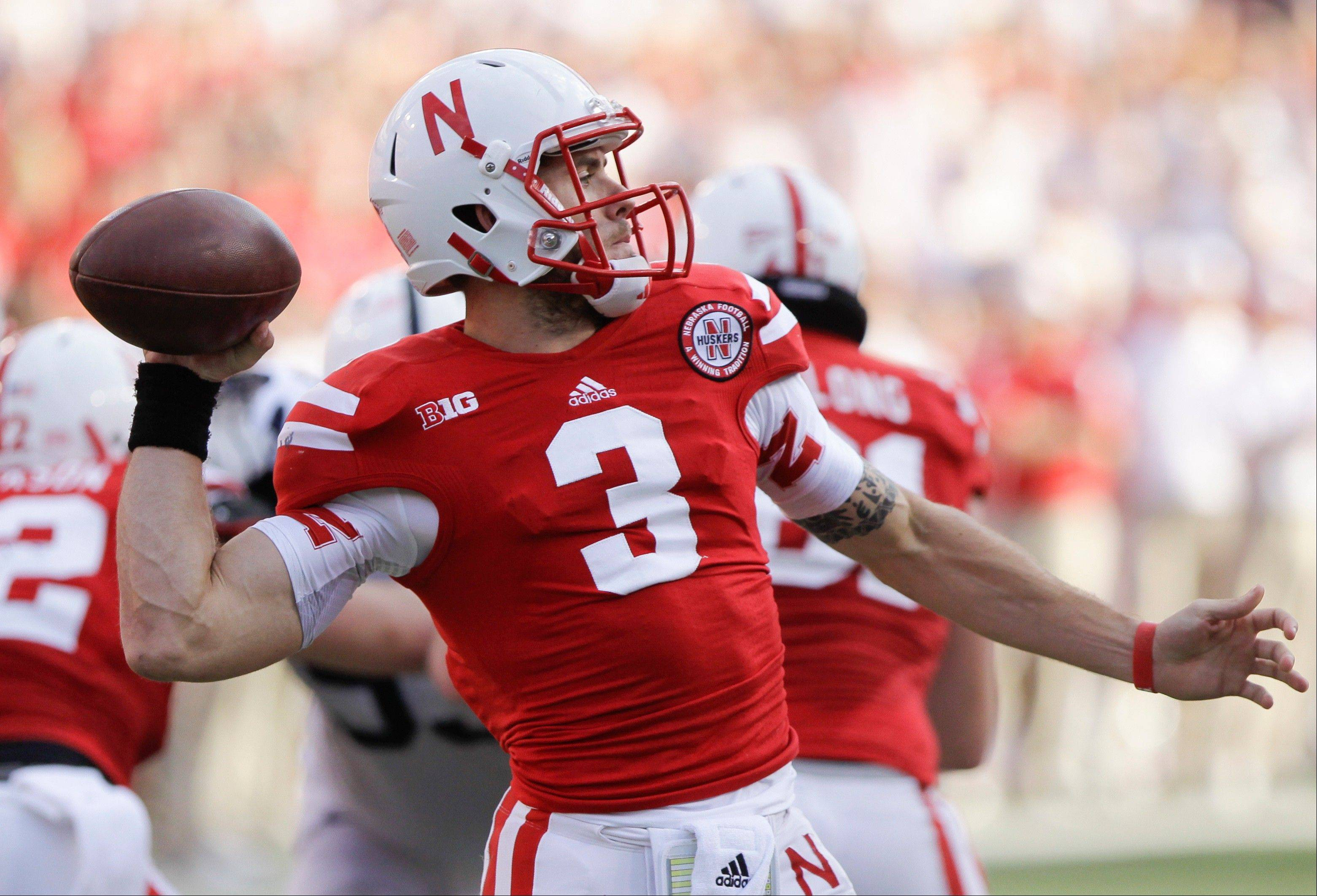 Nebraska quarterback Taylor Martinez throws Saturday during the first half against Penn State in Lincoln.
