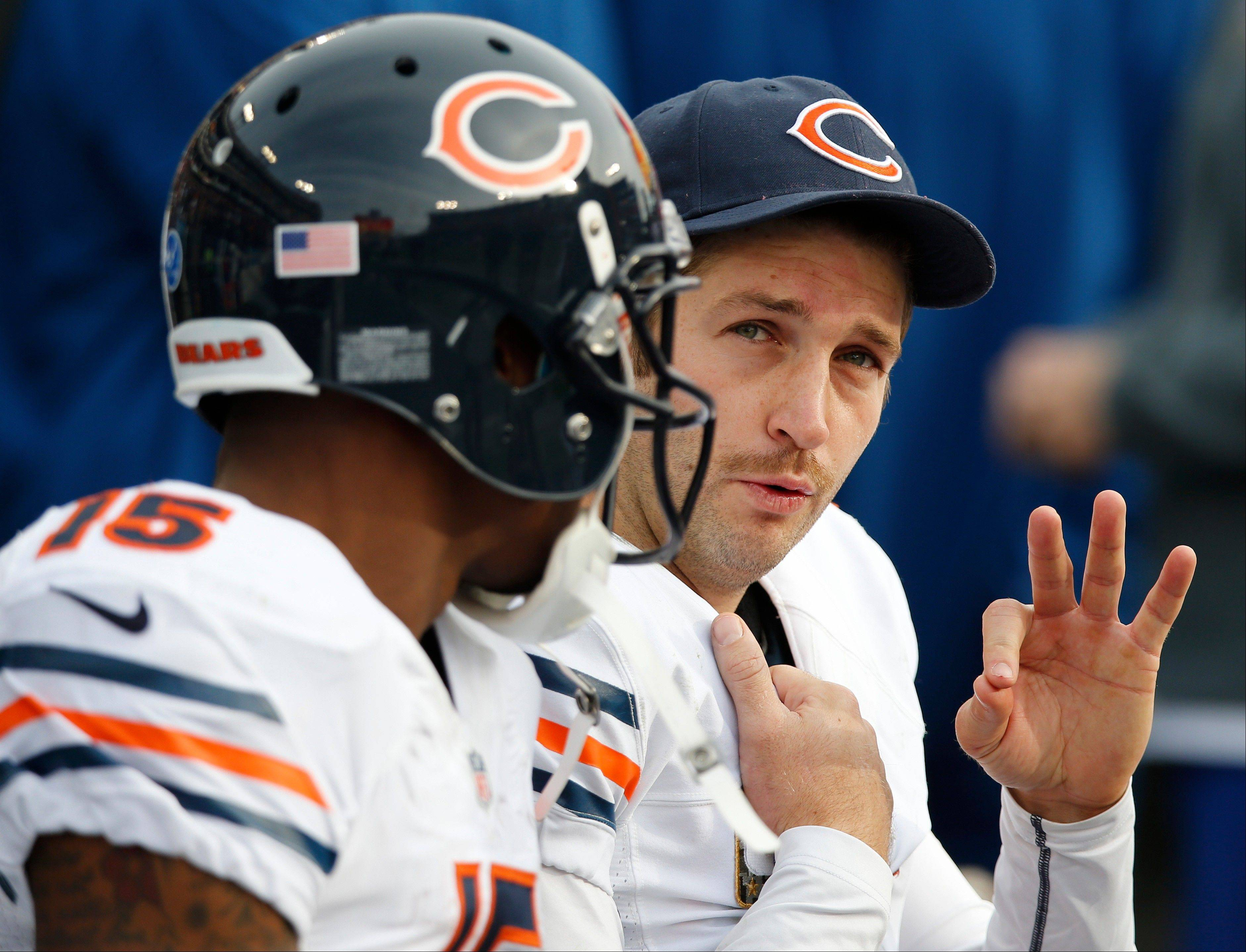 Bears quarterback Jay Cutler, right, and wide receiver Brandon Marshall take a break on the bench after Cutler threw a touchdown pass to Marshall against the Tennessee Titans in the fourth quarter last Sunday in Nashville. The Bears offense has flourished in the fourth, but struggled early in games.