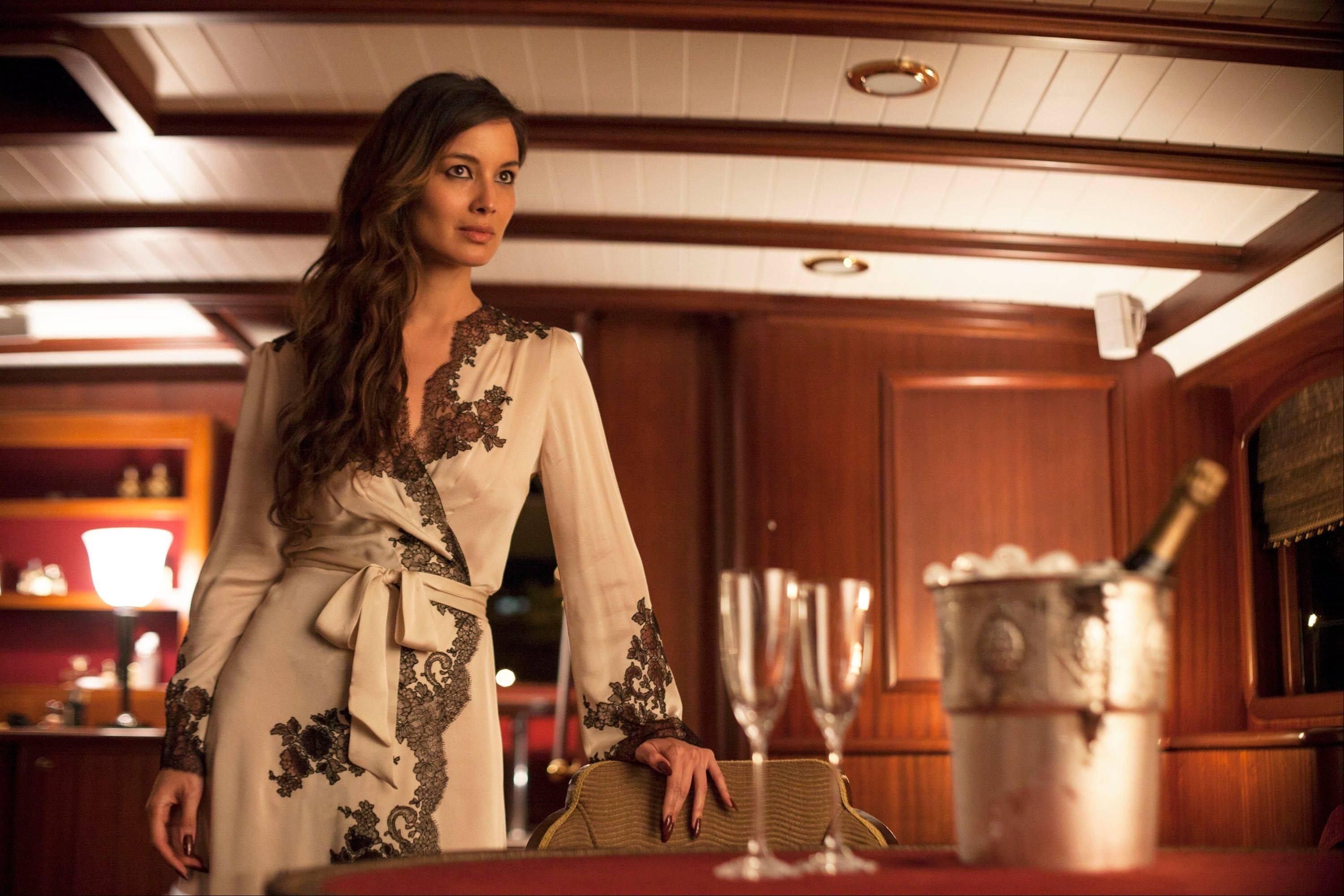"This film image released by Sony Pictures shows Berenice Marlohe in a scene from the film ""Skyfall."" Costume designer Jany Temime says her mantra for the entire wardrobe of �Skyfall,� which opens Friday, was �iconic for 2012.� For Marlohe, Temime envisioned an Ava Gardner type."