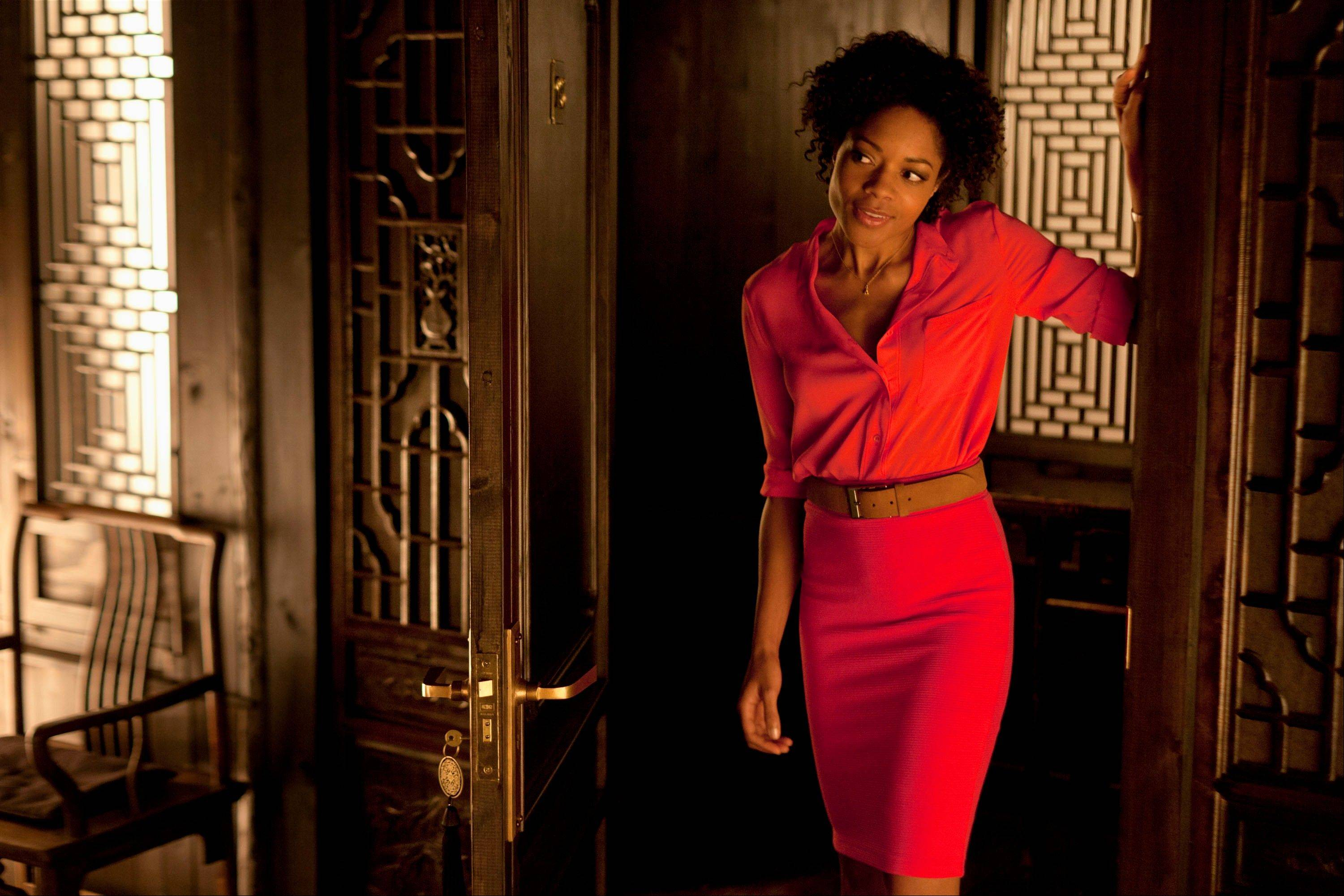"This film image released by Sony Pictures shows Naomie Harris in a scene from the film ""Skyfall."" Costume designer Jany Temime says her mantra for the entire wardrobe of ""Skyfall,"" which opens Friday, was �iconic for 2012."