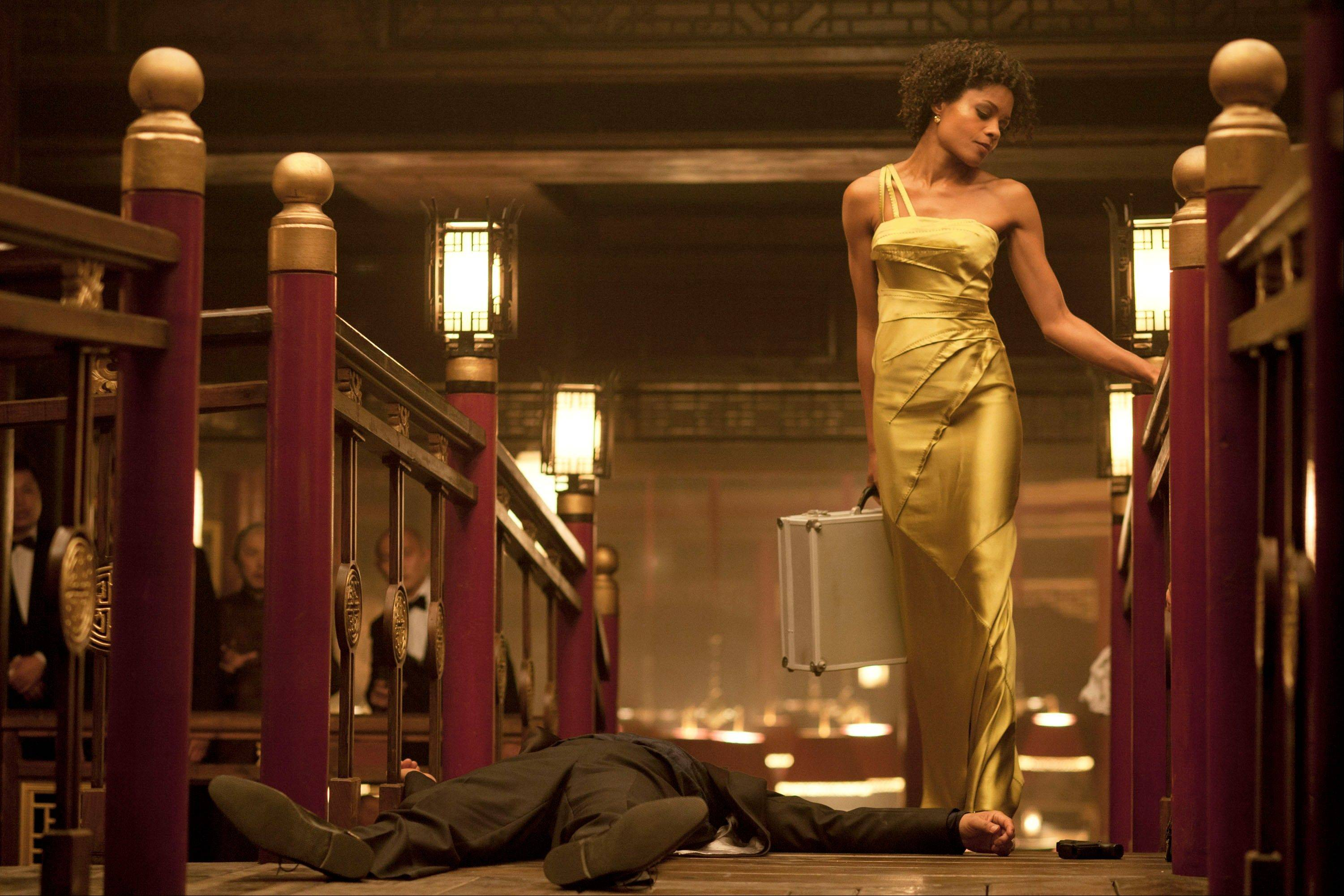"This film image released by Sony Pictures shows Naomie Harris in a scene from the film ""Skyfall."" Costume designer Jany Temime says her mantra for the entire wardrobe of ""Skyfall."""