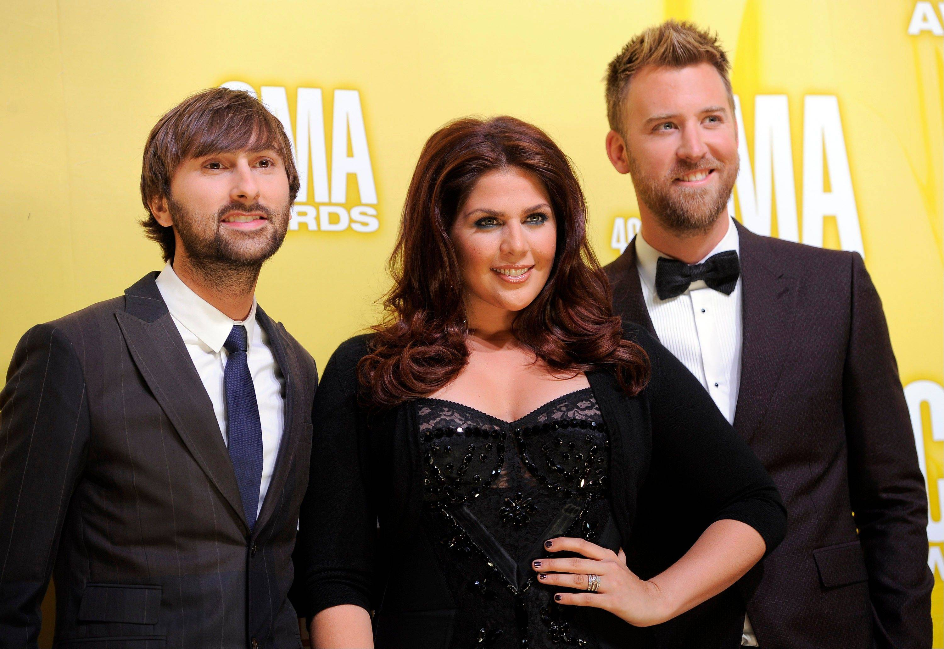 Members of the band Lady Antebellum, from left, Dave Haywood, Hillary Scott and Charles Kelley at the 46th Annual Country Music Awards at the Bridgestone Arena in Nashville, Tenn. The trio won the breakthrough award at the 2012 Billboard Touring Awards on Thursday, Nov. 8, 2012, in New York, for the success it had on its million-selling Own the Night world tour.