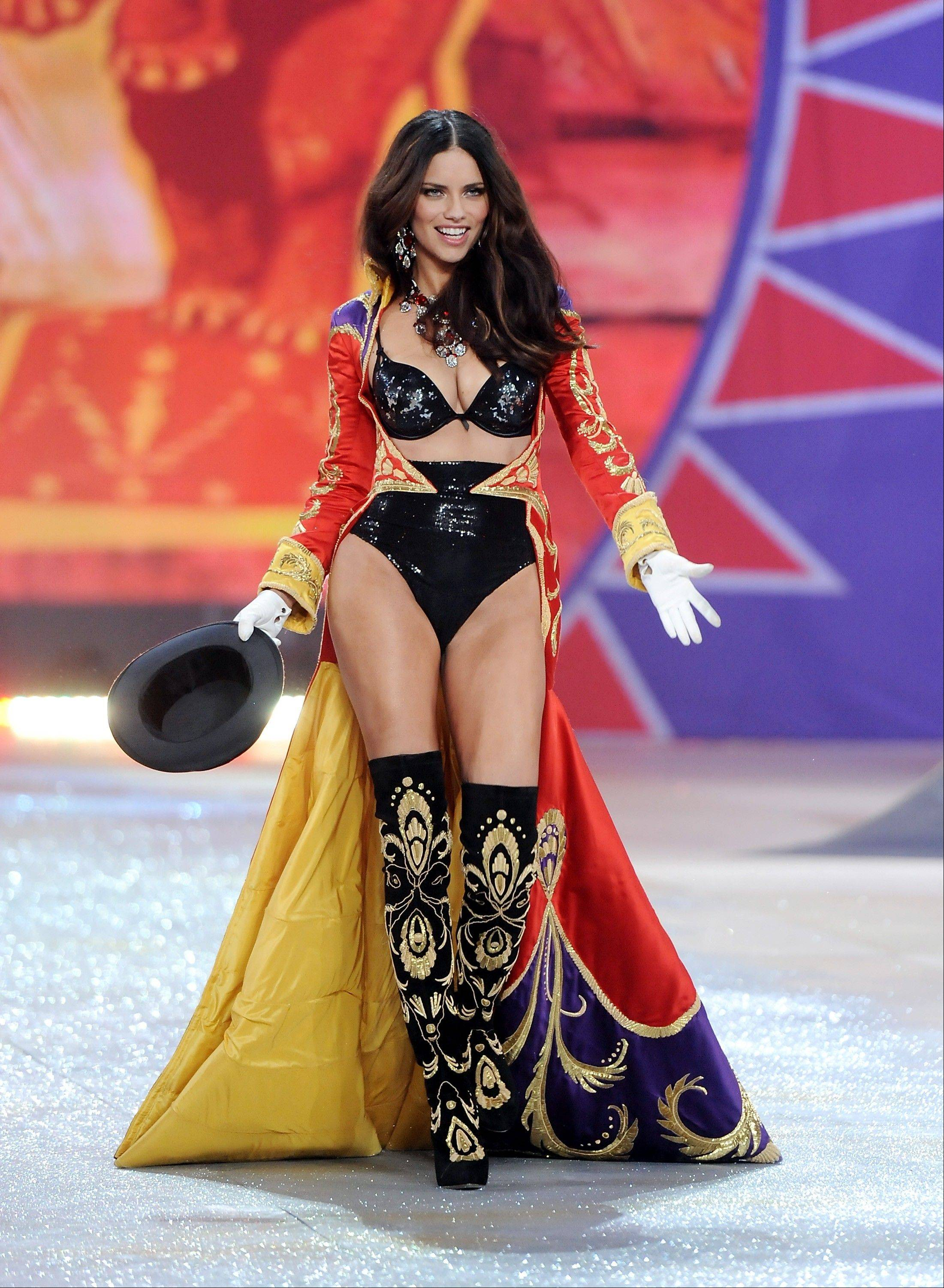 Brazilian model Adriana Lima walks on the runway during the 2012 Victoria's Secret Fashion Show.
