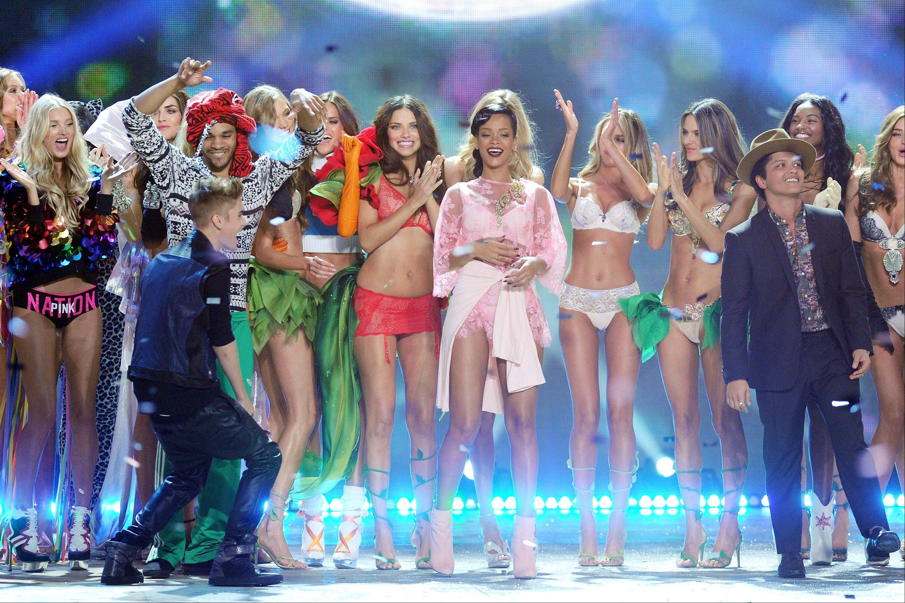 Singers Justin Bieber, Rihanna and Bruno Mars celebrate during the finale of the 2012 Victoria's Secret Fashion Show.