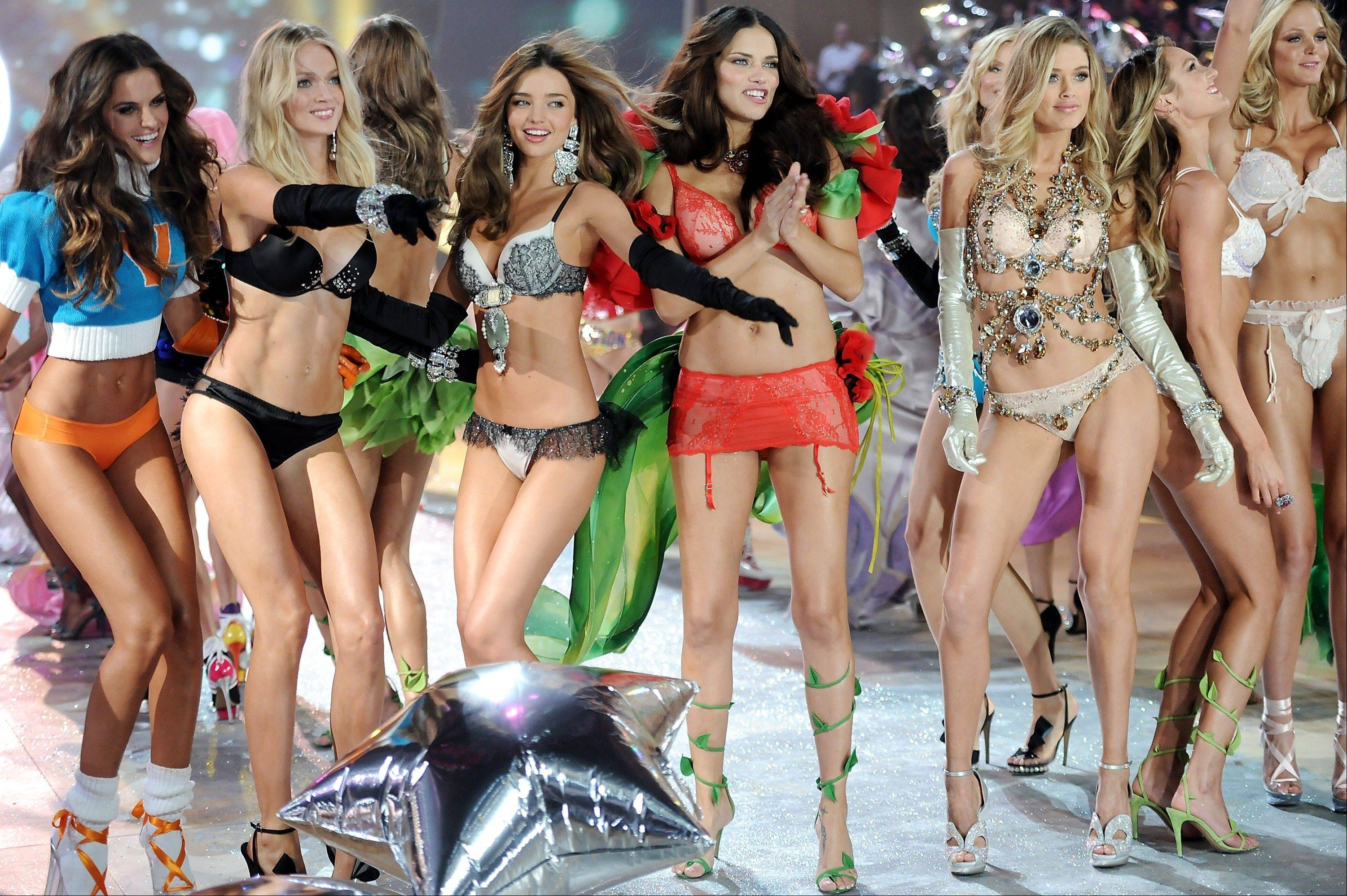 Models, from left, Izabel Goulart, Lindsay Ellingson, Miranda Kerr, Adriana Lima, Doutzen Kroes and Candice Swanepoel walk the runway during the finale of the 2012 Victoria's Secret Fashion Show.
