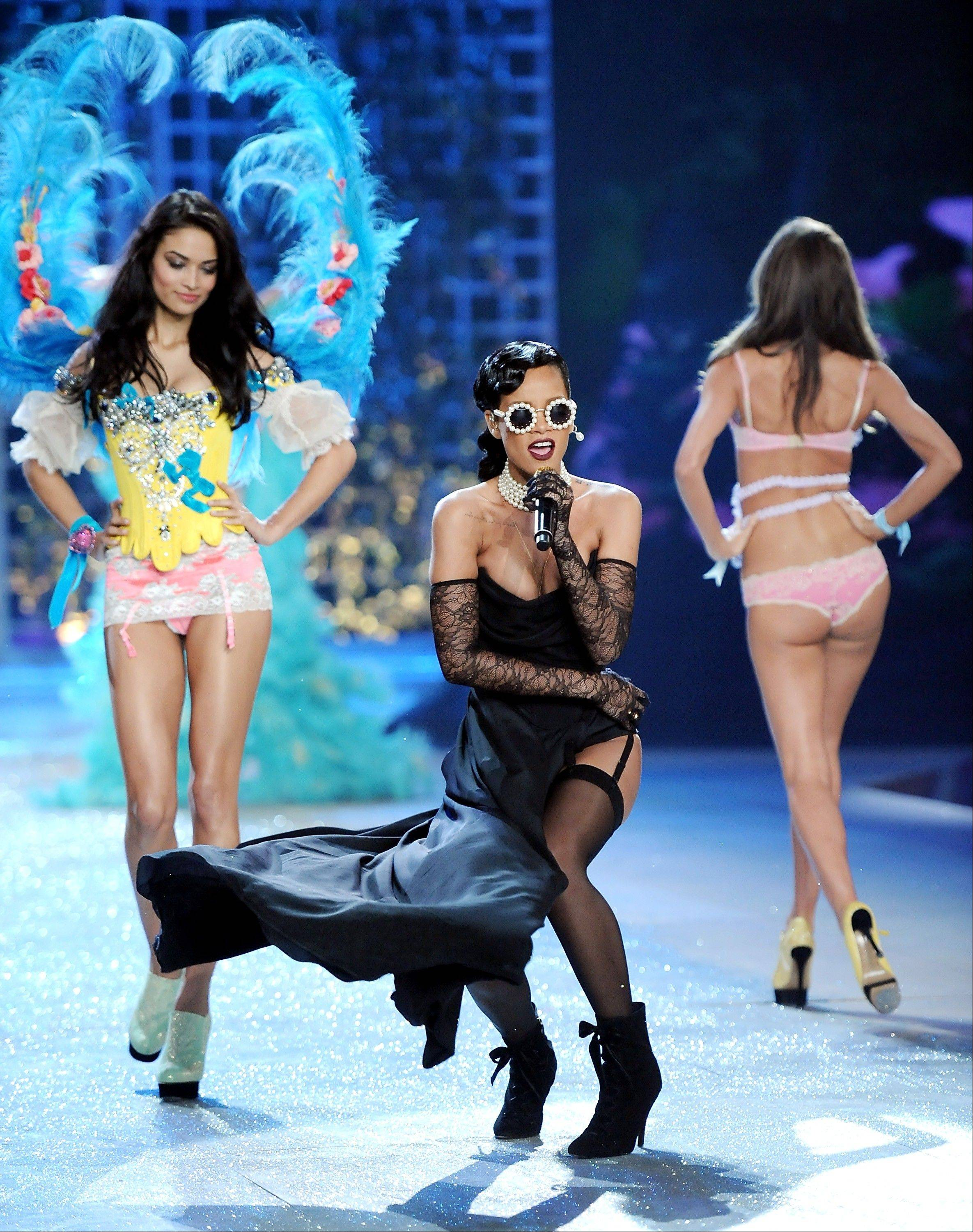 Singer Rihanna, center, performs while models walk the runway during the 2012 Victoria's Secret Fashion Show.