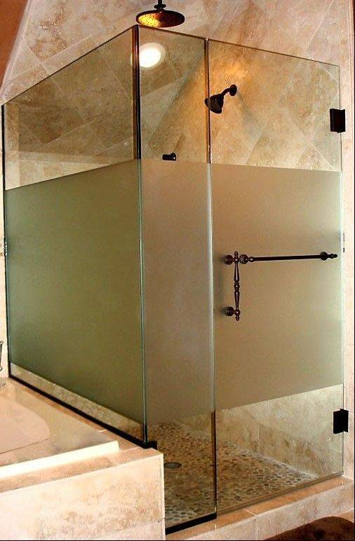 Frameless glass showers are easy to clean and showcase modern stone tile used in many of today's baths.