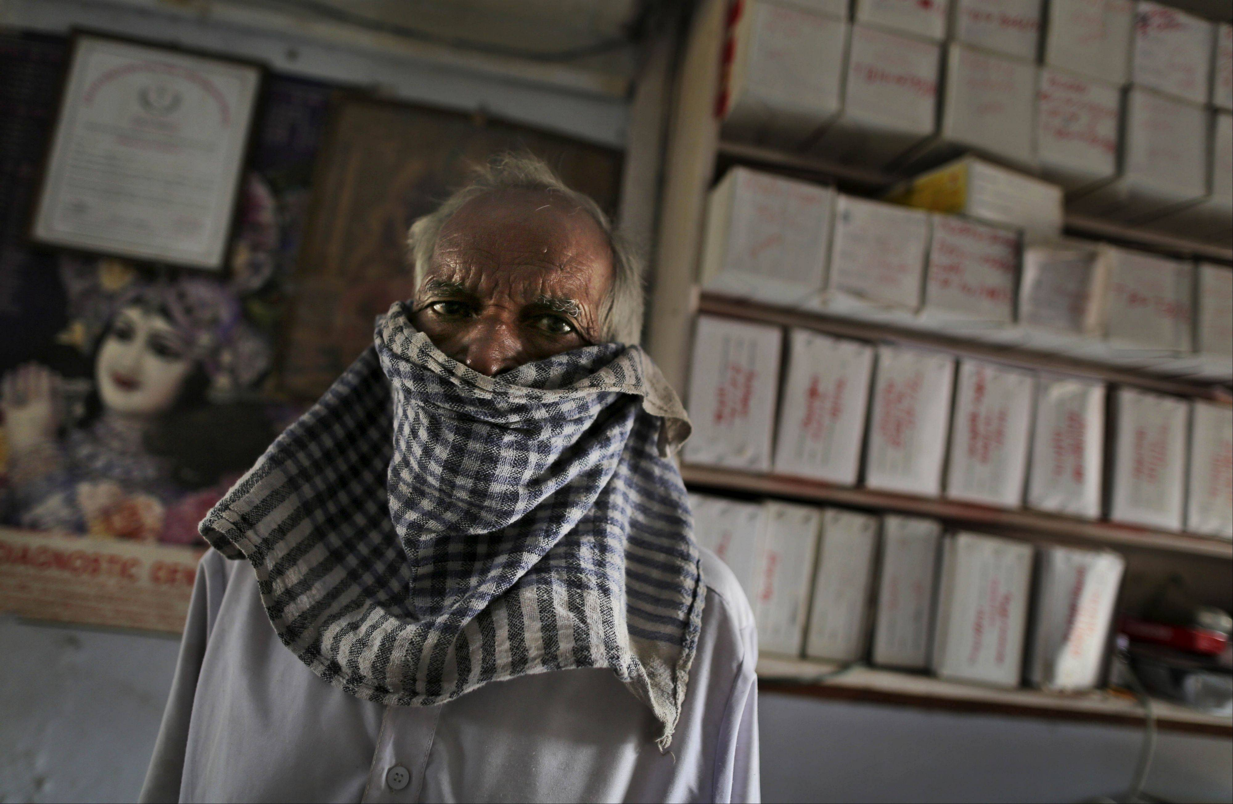 Associated Press/Oct. 22, 2012A tuberculosis patient, wearing a cloth over his mouth, waits in front of boxes of medication at an Operation ASHA program center in New Delhi.