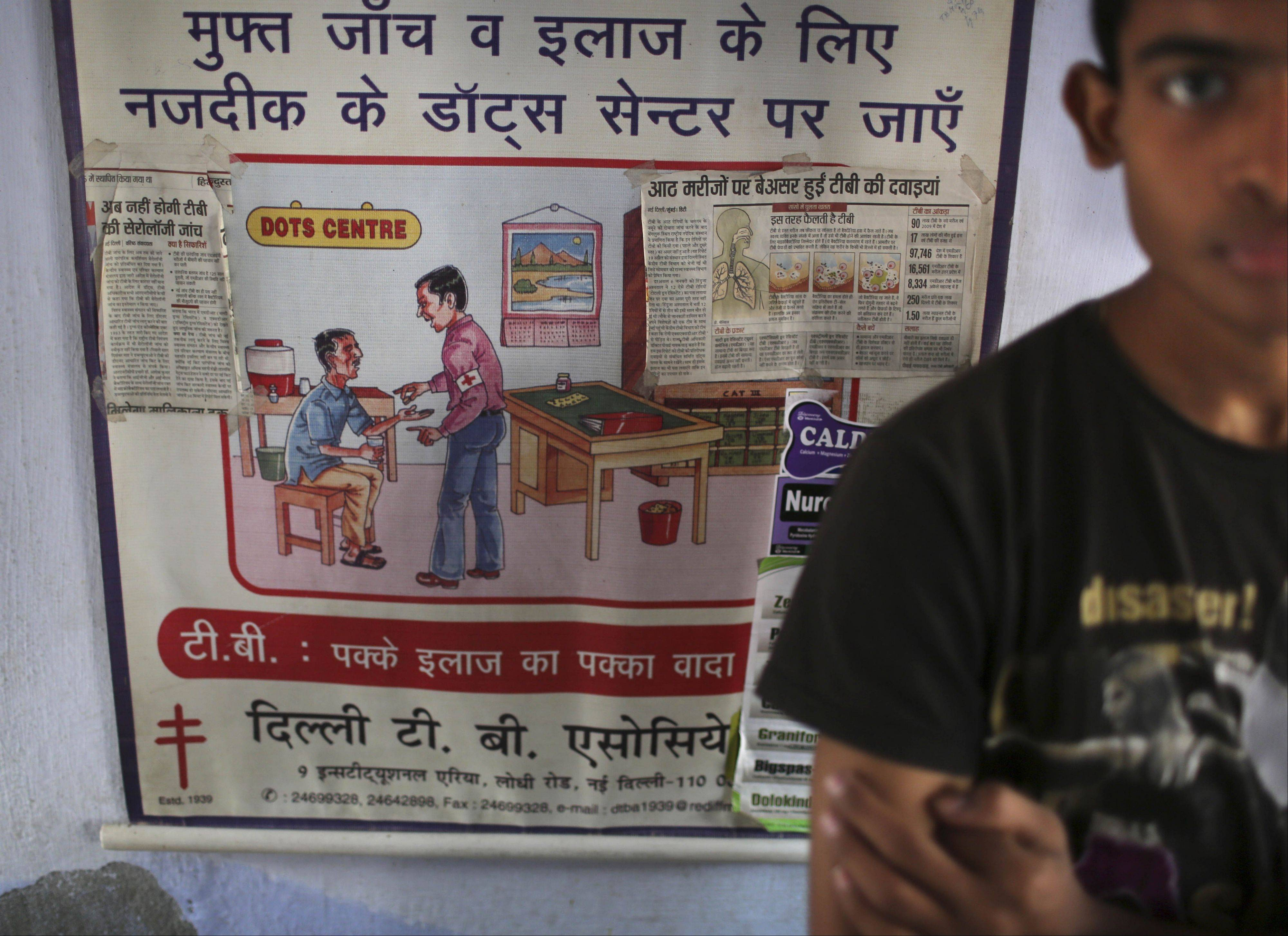 Associated Press/Oct. 22, 2012A teen waits next to a poster at an Operation ASHA program center in New Delhi.