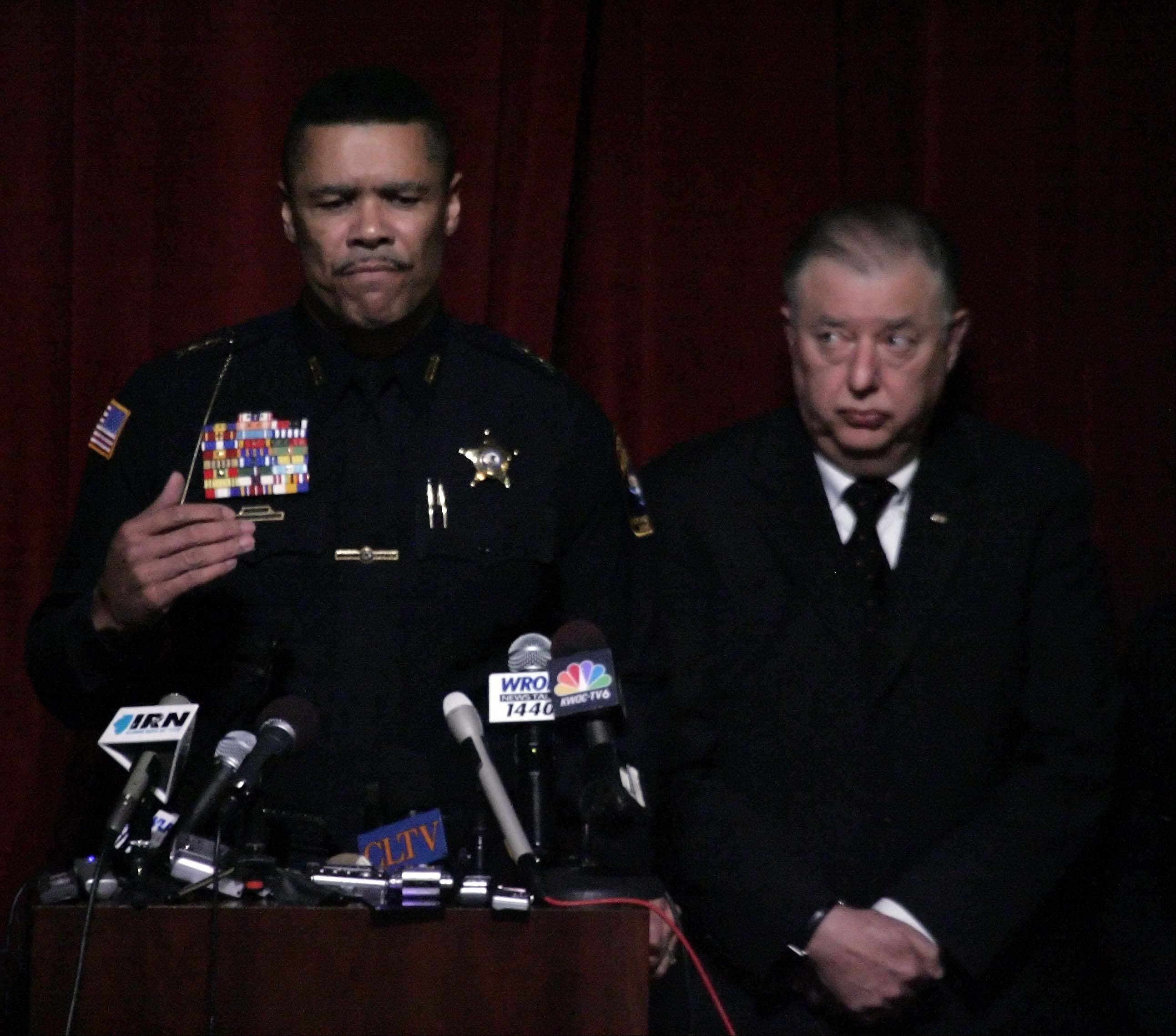 NIU Police Chief Donald Grady, left, stands with NIU President John Peters to address the 2008 campus shootings that left five students dead.
