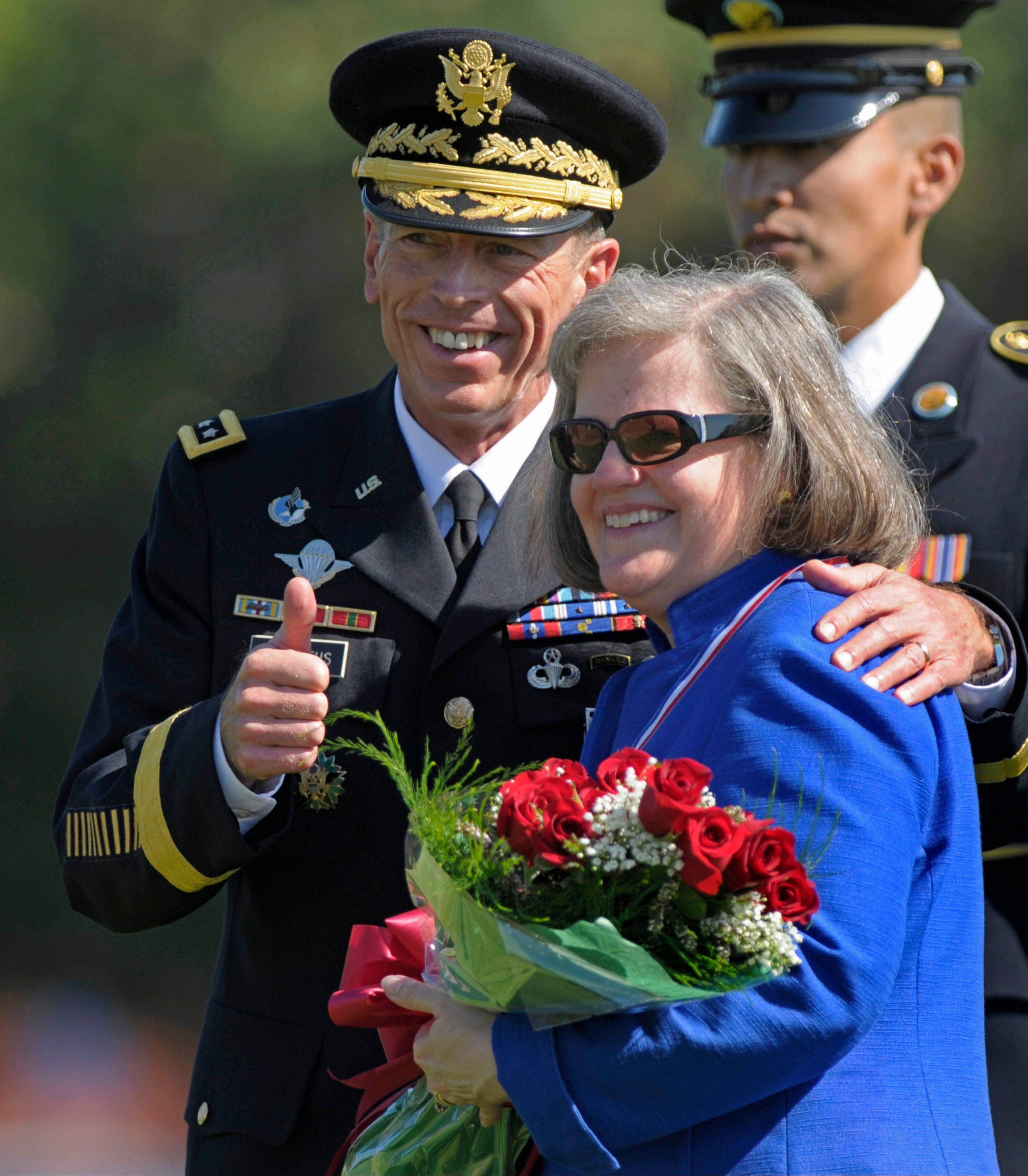 Former Commander of International Security Assistance Force and U.S. Forces-Afghanistan Gen. Davis Petraeus, standing with his wife Holly, participates in an armed forces farewell tribute and retirement ceremony at Joint Base Myer-Henderson Hall in Arlington, Va.