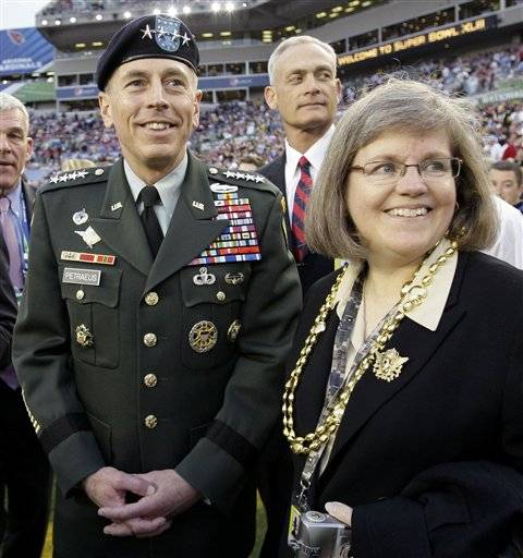 Gen. David Petraeus, commander U.S. Central Command, left, stands with his wife Holly before the NFL Super Bowl XLIII football game between the Arizona Cardinals and the Pittsburgh Steelers in Tampa, Fla. Gen. Petraeus, the retired four-star general who led the U.S. military campaigns in Iraq and Afghanistan, resigned Friday, Nov. 9, 2012 as director of the CIA after admitting he had an extramarital affair.