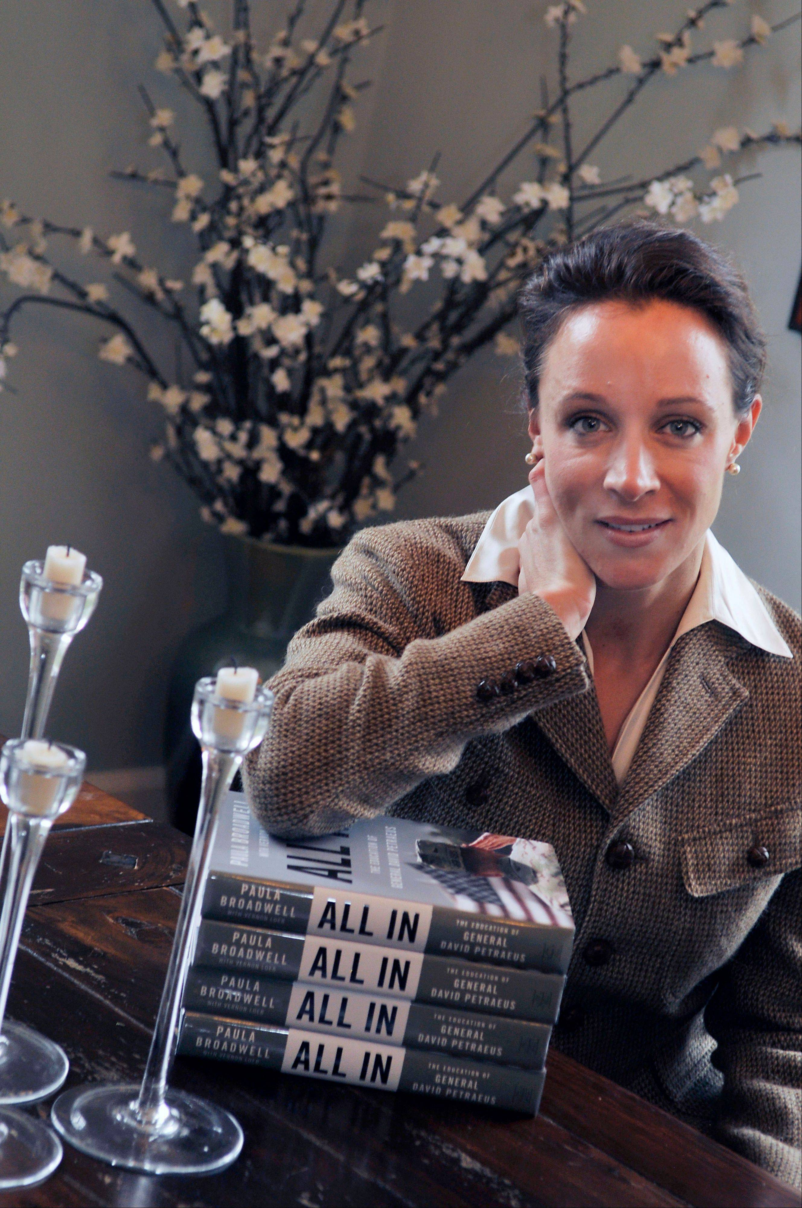 "$PHOTOCREDIT_ON$$PHOTOCREDIT_OFF$Paula Broadwell, author of the David Petraeus biography ""All In,"" poses for photos in Charlotte, N.C."