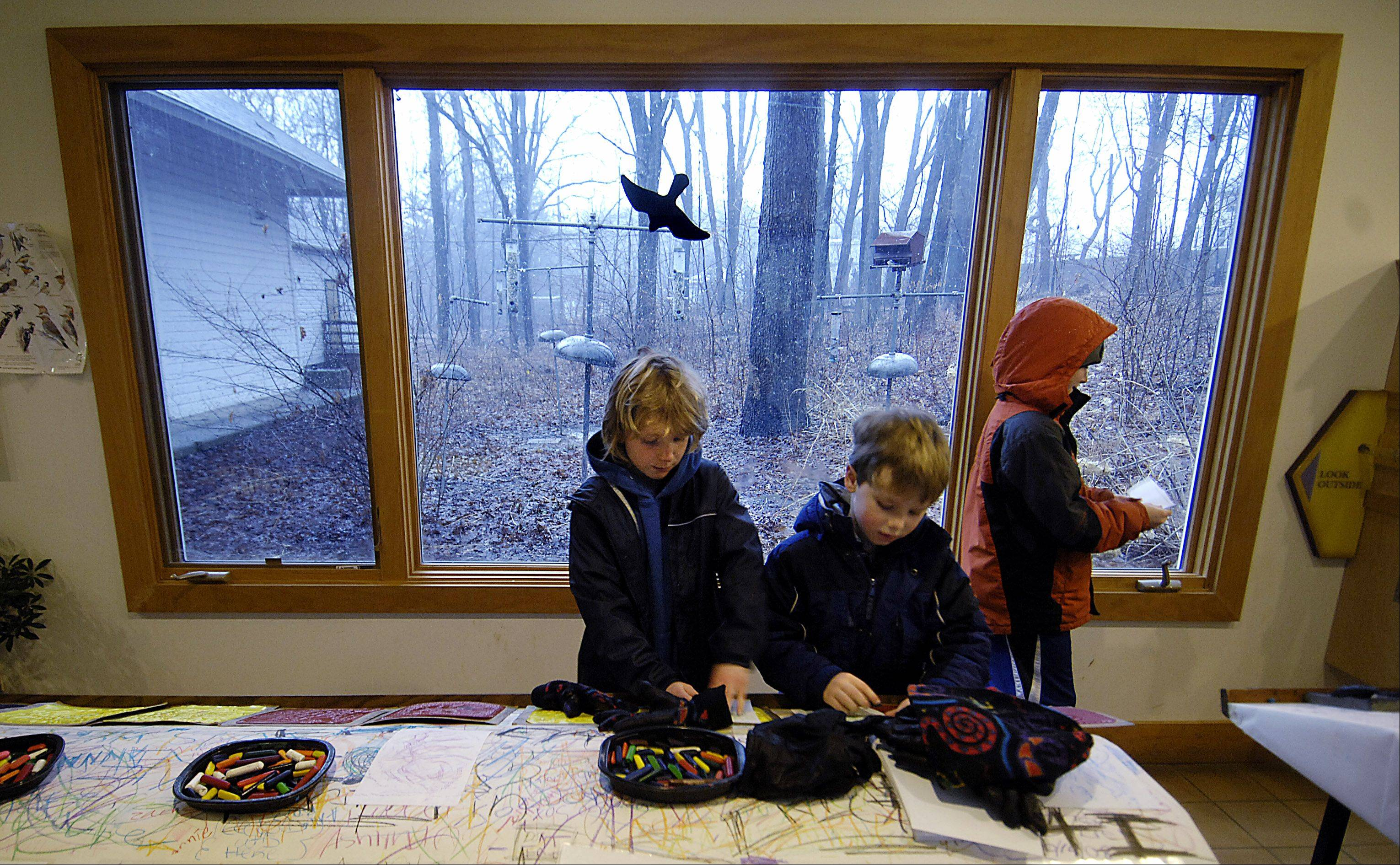 Many children have made nature-themed crafts at the Tekakwitha Woods Nature Center over the years. Shown are, from left, Keaton Jens, 8; Matthew Clancy, 6; and Peter Clancy, 10, all of St. Charles, during the annual Maple Sugaring Festival.