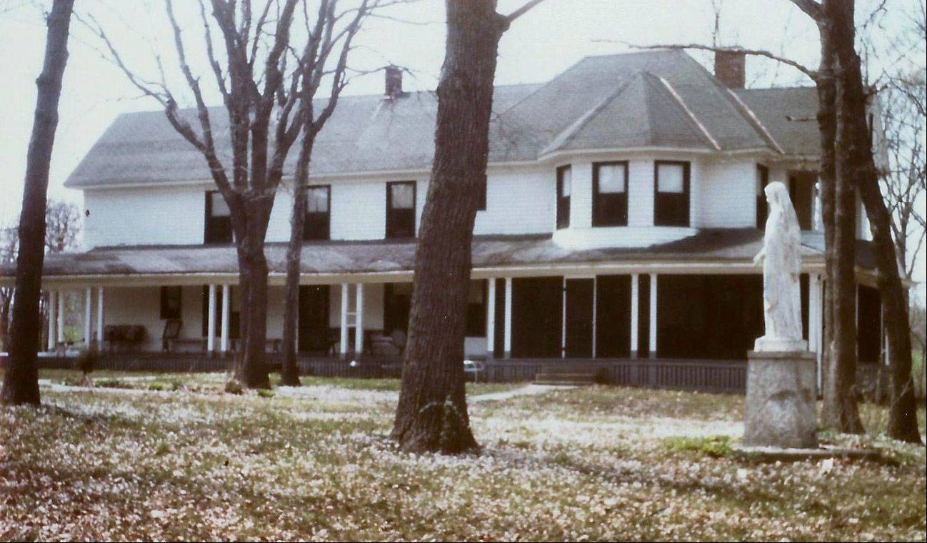 The McGuire House on the grounds of Tekakwitha Woods. The home of the late Father Hugh McGuire was used until recently as an office and classroom area for the Kane County Forest Preserve. Valerie Blaine's office was on the second floor; the windows in the cupola on the right.
