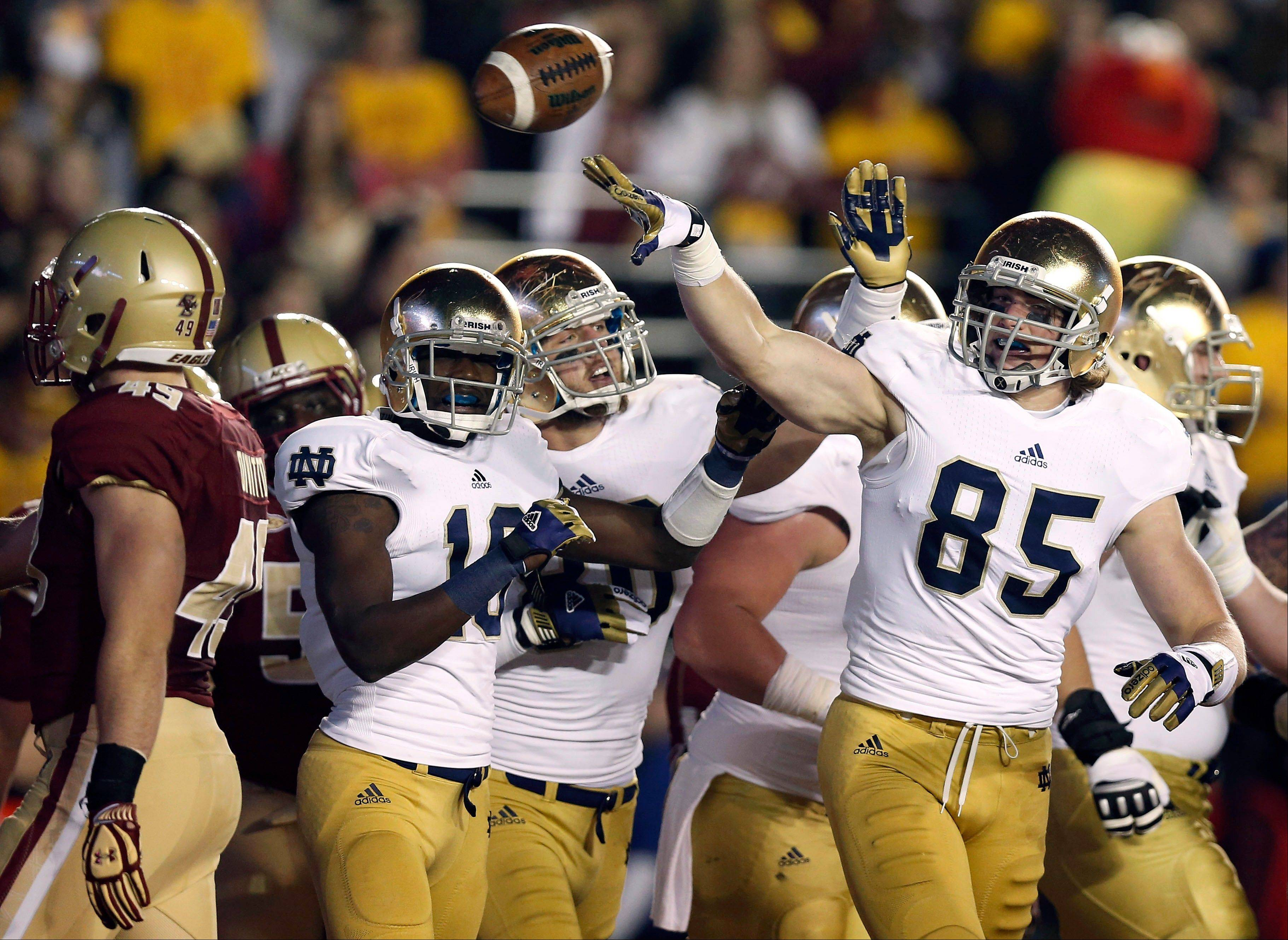 Notre Dame tight end Troy Niklas (85) celebrates with teammates Saturday after catching a touchdown pass against the Boston College during the first half in Boston.