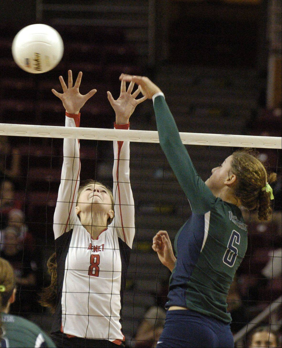 Benet's Nicki Barnes goes for a block while Taylor Tashima taps the ball.