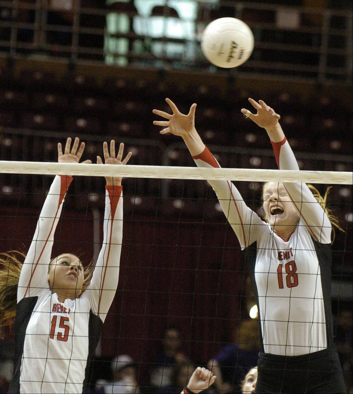 Hannah Kaminsky, left, and Rachael Fara go for a block during the Benet Academy and New Trier Class 4A championship volleyball game Saturday.
