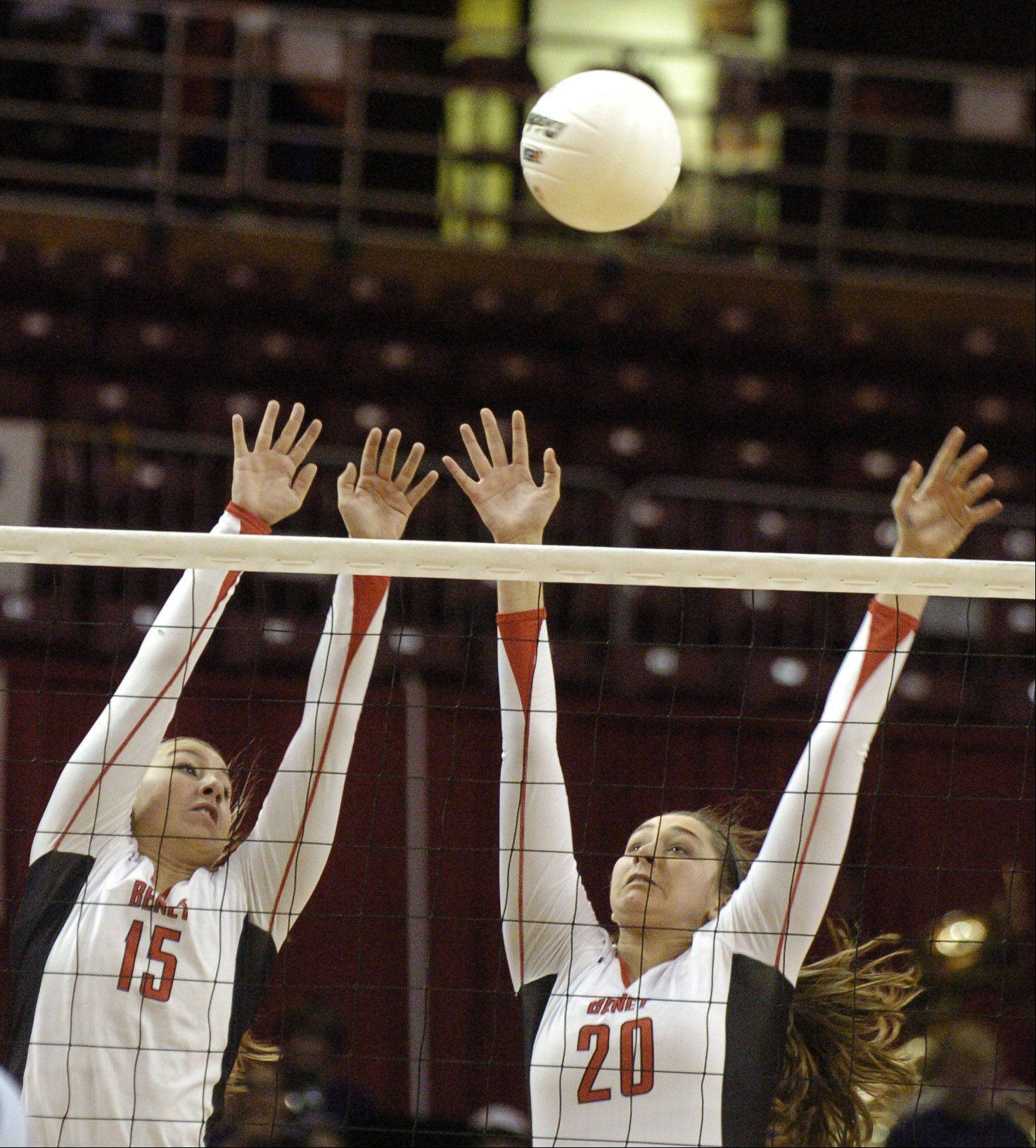 Hannah Kaminsky, left and Brittany Pavich of Benet go up for a block.