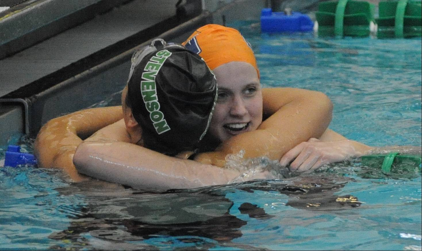 Buffalo Grove's Veronika Jedryka, facing, and Stevenson's Julia Wawer celebrate after finishing 1-2 in the 100-yard freestyle at Saturday's Stevenson sectional.