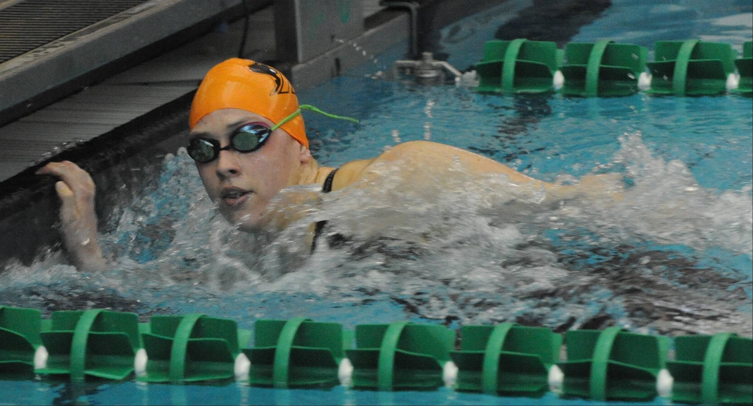 Hersey senior Amanda Petro gets to the wall with a winning effort in the 200-yard IM at Saturday's Stevenson sectional.