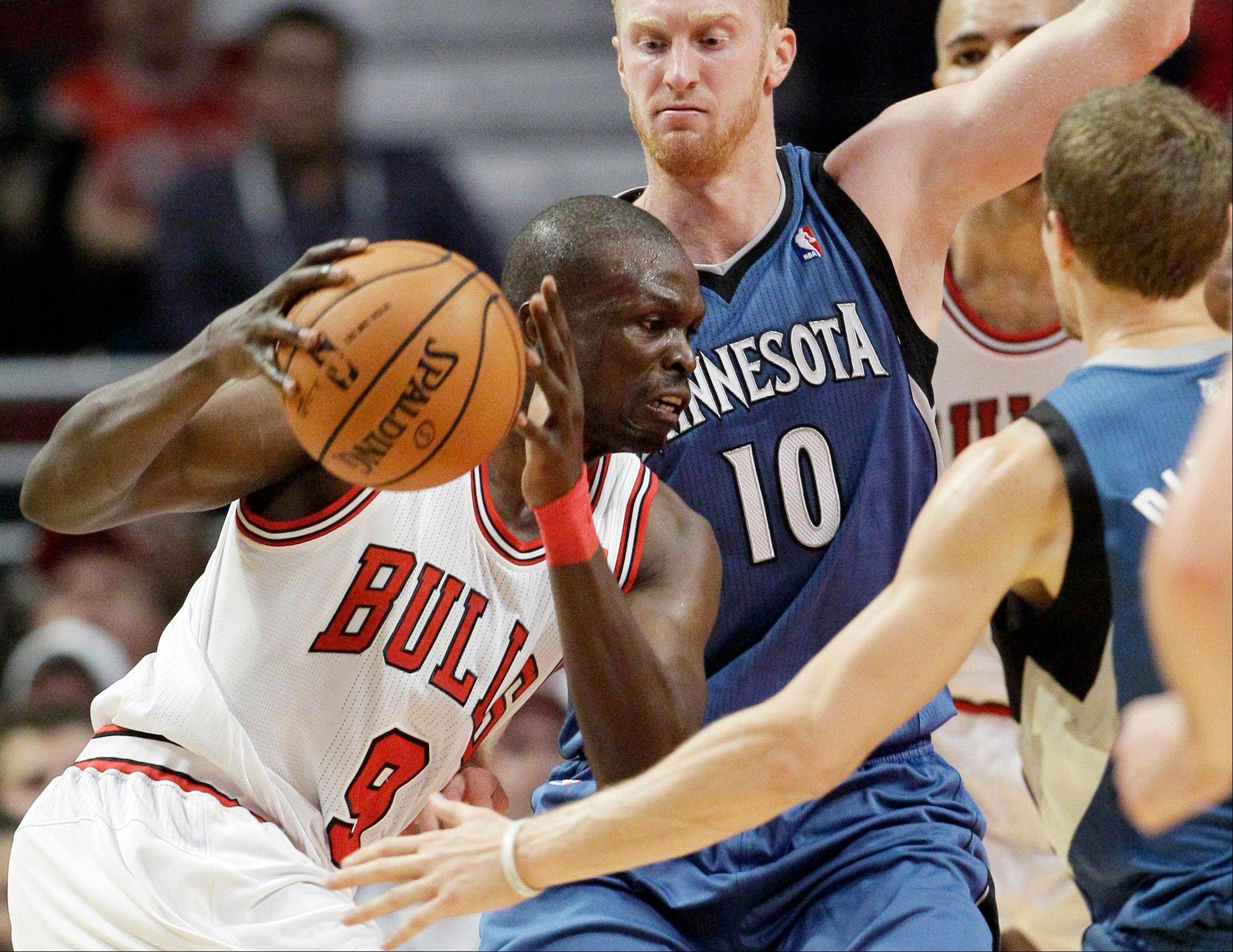 Bulls forward Luol Deng drives to the basket as Minnesota Timberwolves forward Chase Budinger guards Saturday during the first half at the United Center.