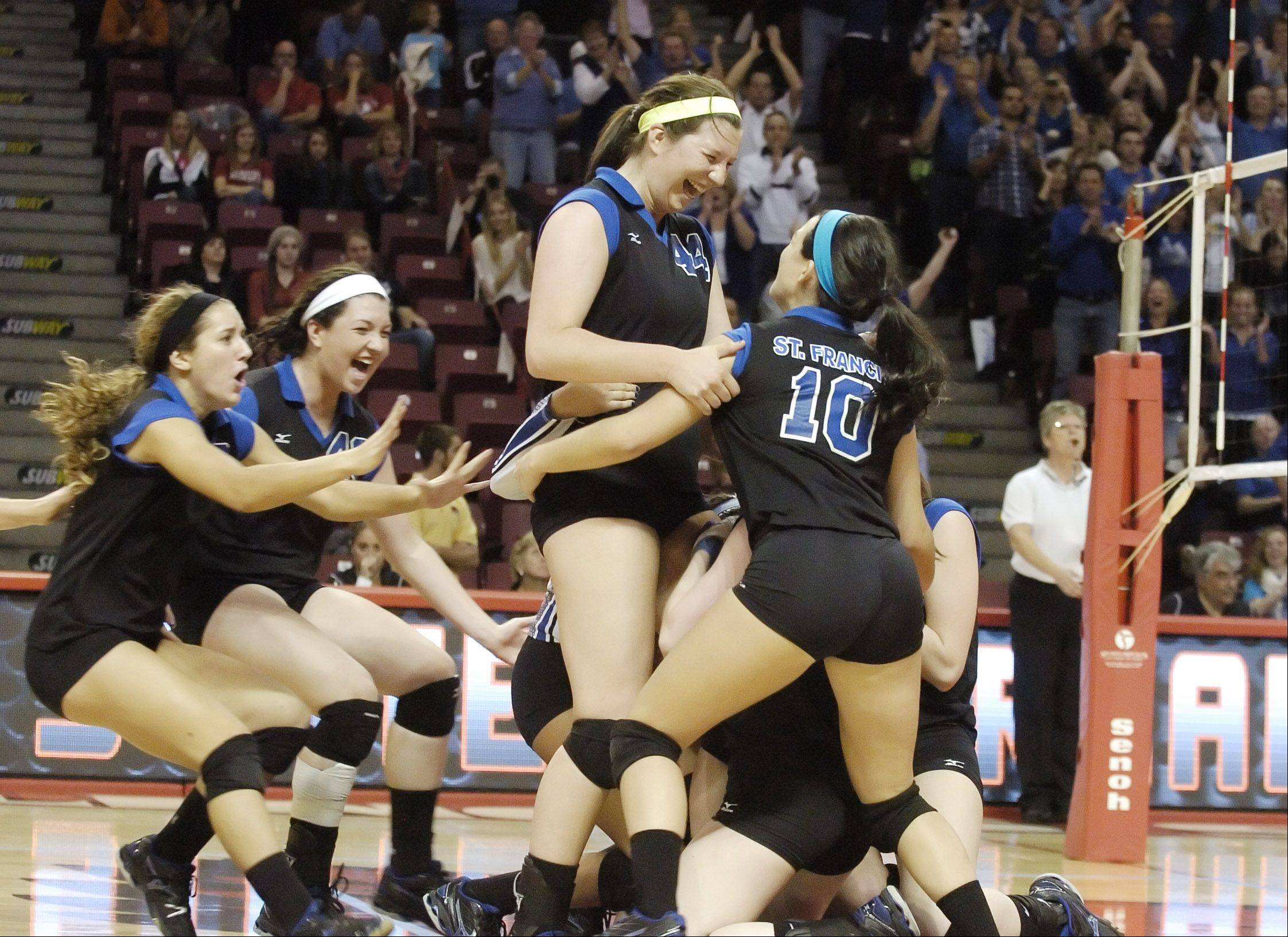 PAUL MICHNA/PMICHNA@DAILYHERALD.COMThe St. Francis girls react to their win during the class 3A girls volleyball championship Saturday at Redbird Arena, on Illinois State campus in Bloomington-Normal.
