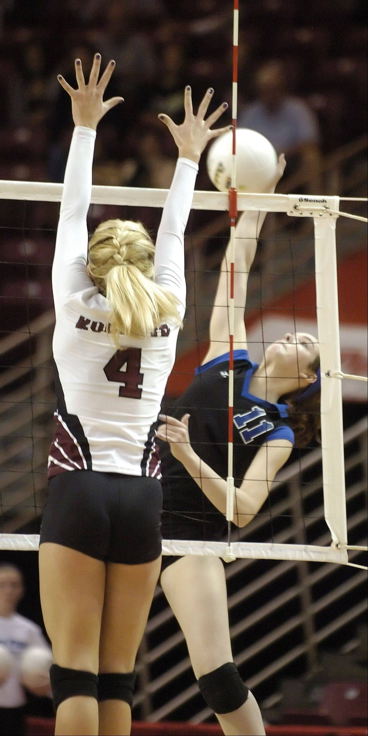 Kim Russell of Richmond-Burton,left, goes up for a block while Becca Shearer spikes the ball. This took place during the class 3A girls volleyball championship Saturday at Redbird Arena, on Illinois State campus in Bloomington-Normal.
