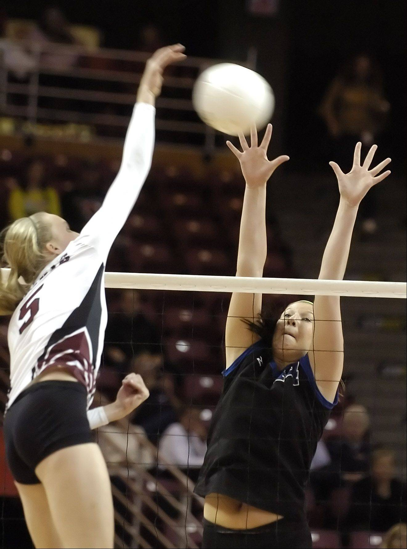 Richmond-Burton's Ali Frantti, left, spikes the ball past St. Francis' Maddie Haggerty during Saturday's Class 3A state volleyball championship.