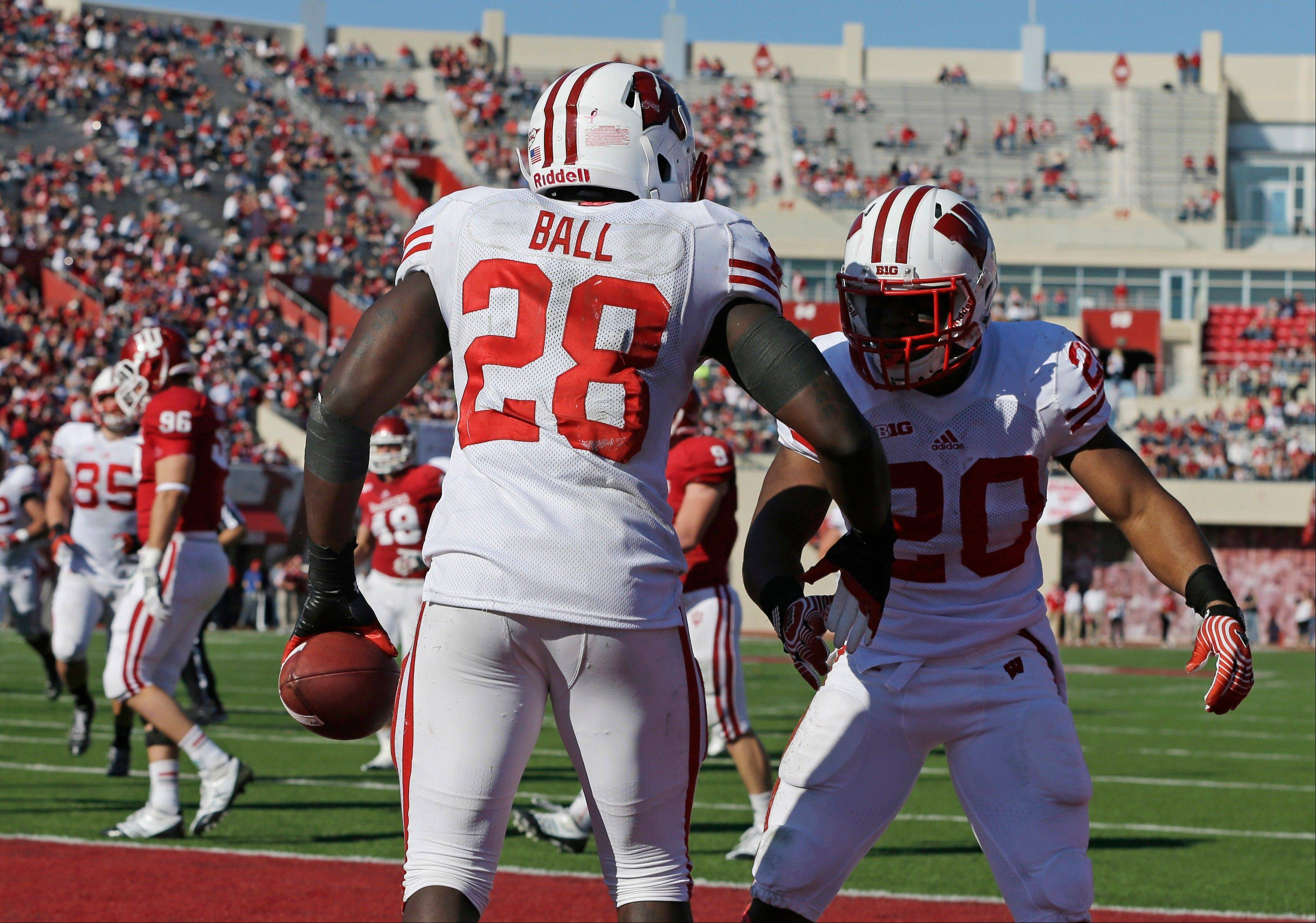Wisconsin's Montee Ball (28) and James White celebrates after Ball ran 49-yards for a touchdown Saturday during the second half against Indiana in Bloomington, Ind.