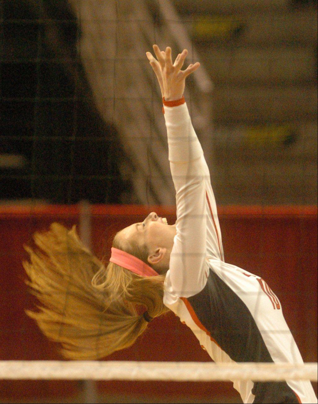 Caroline Wolf of Benet celebrates a point during the class 4A girls volleyball semifinal, Benet vs. Libertyville at Redbird Arena, on Illinois State campus Friday.