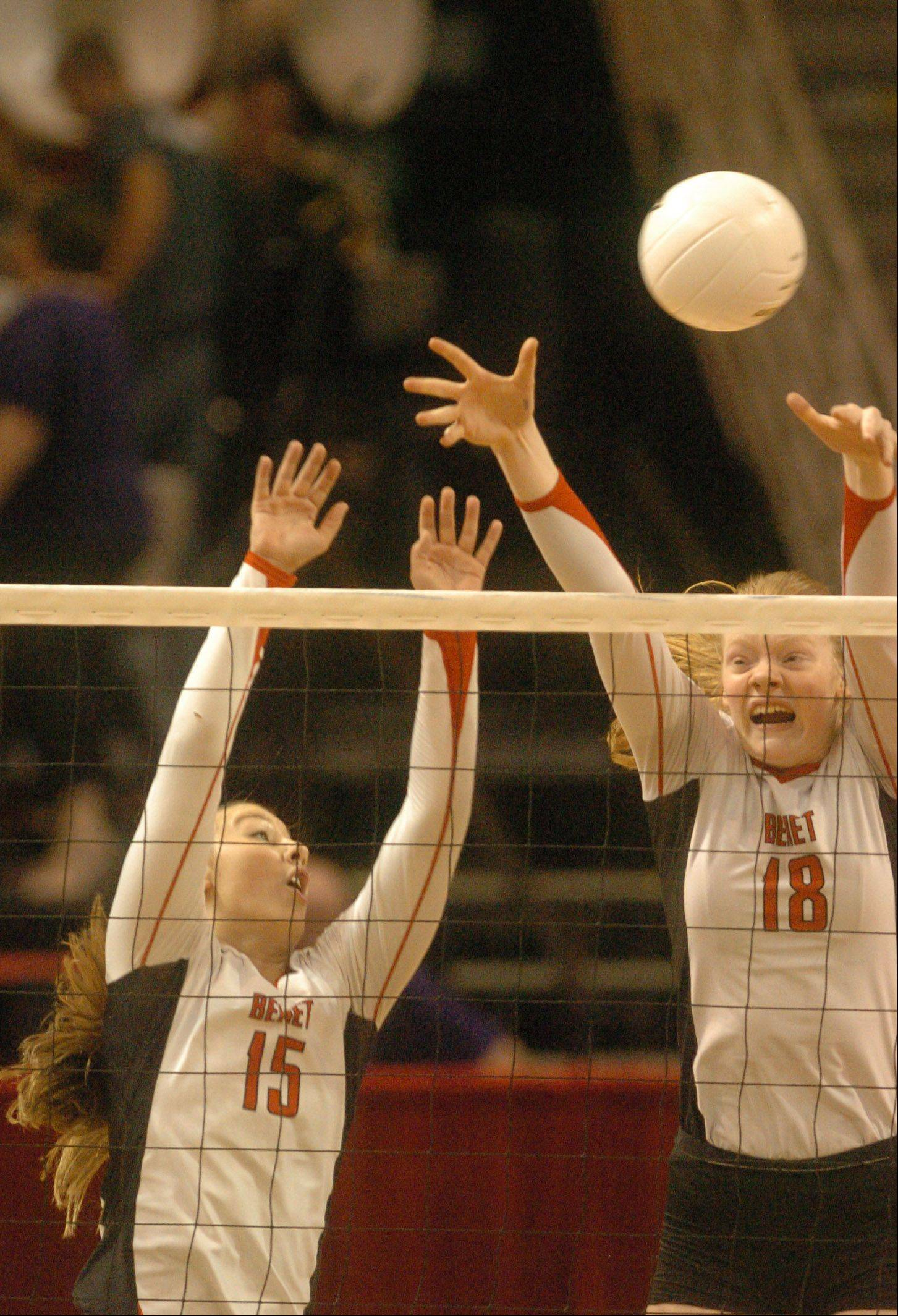 Hannah Kaminsky,left, and Rachael Fara of Benet go up for a block during the Class 4A girls volleyball semifinal, Benet vs. Libertyville at Redbird Arena, on Illinois State campus Friday.