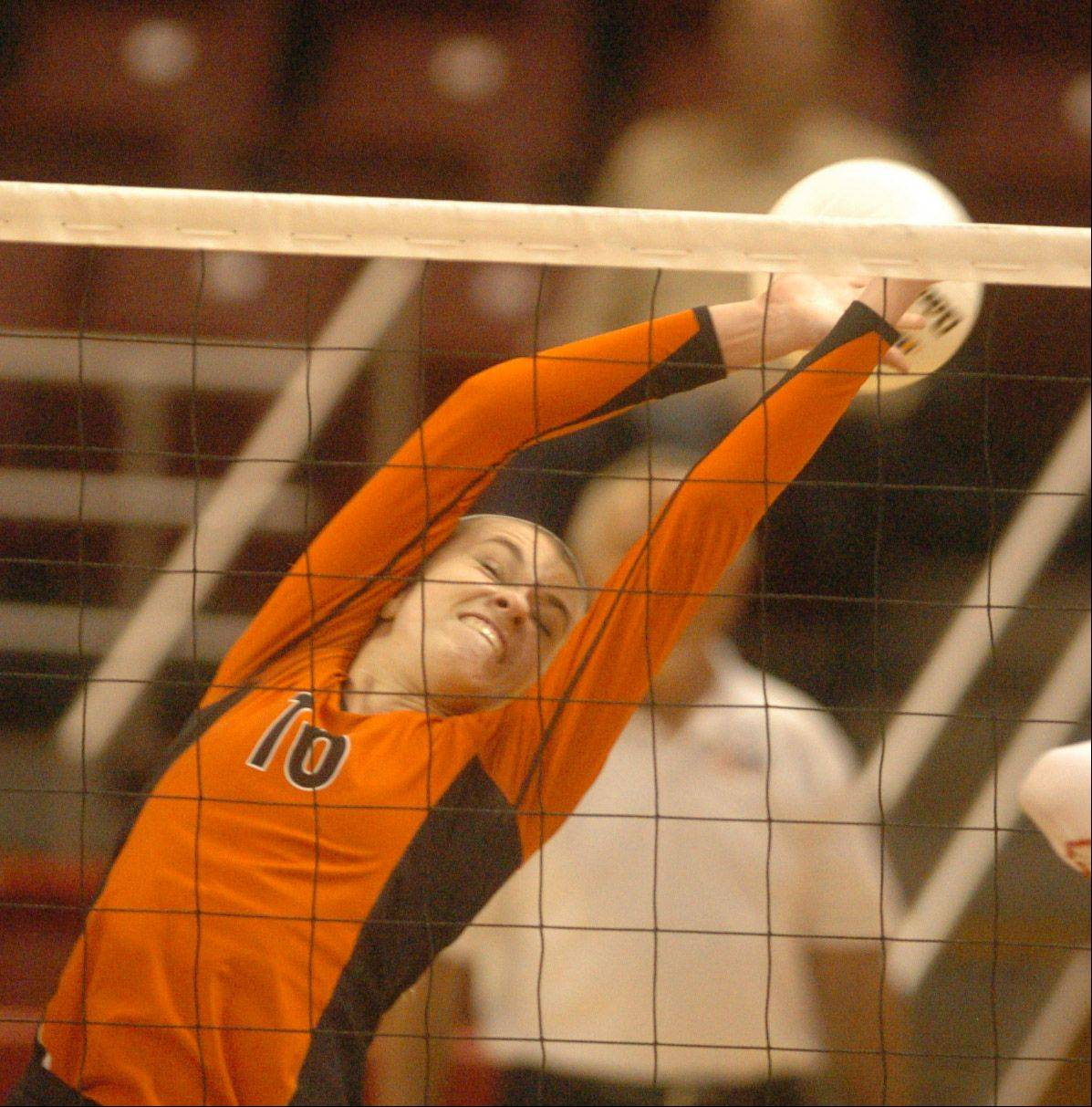 Rhiannon Prentiss of Libertyville stretches for a block during the class 4A girls volleyball semifinal, Benet vs. Libertyville at Redbird Arena, on Illinois State campus Friday.
