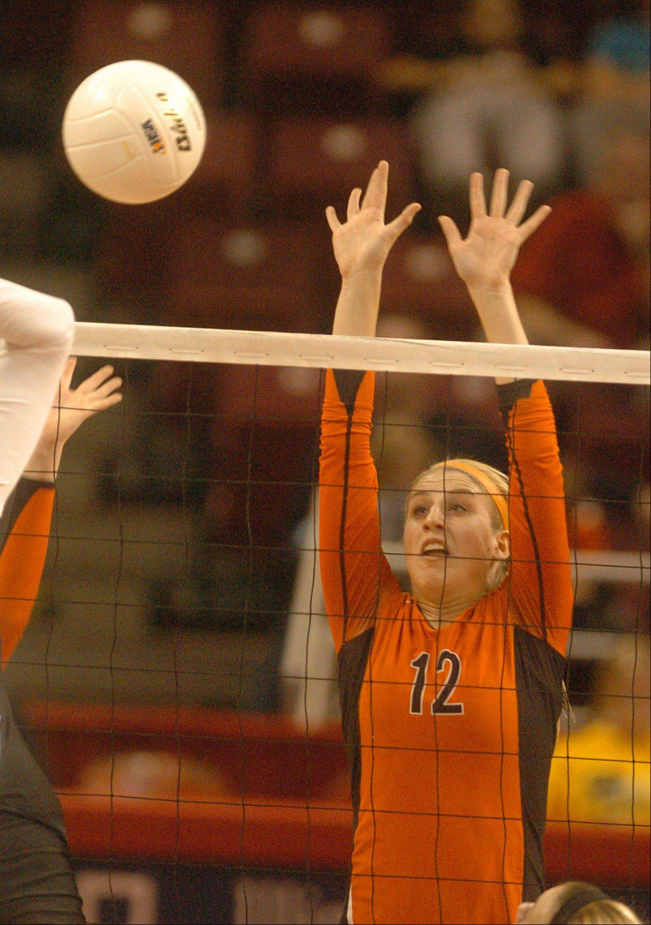 Jordan Bauer of Libertyville goes up for a block during the class 4A girls volleyball semifinal, Benet vs. Libertyville at Redbird Arena, on Illinois State campus Friday.