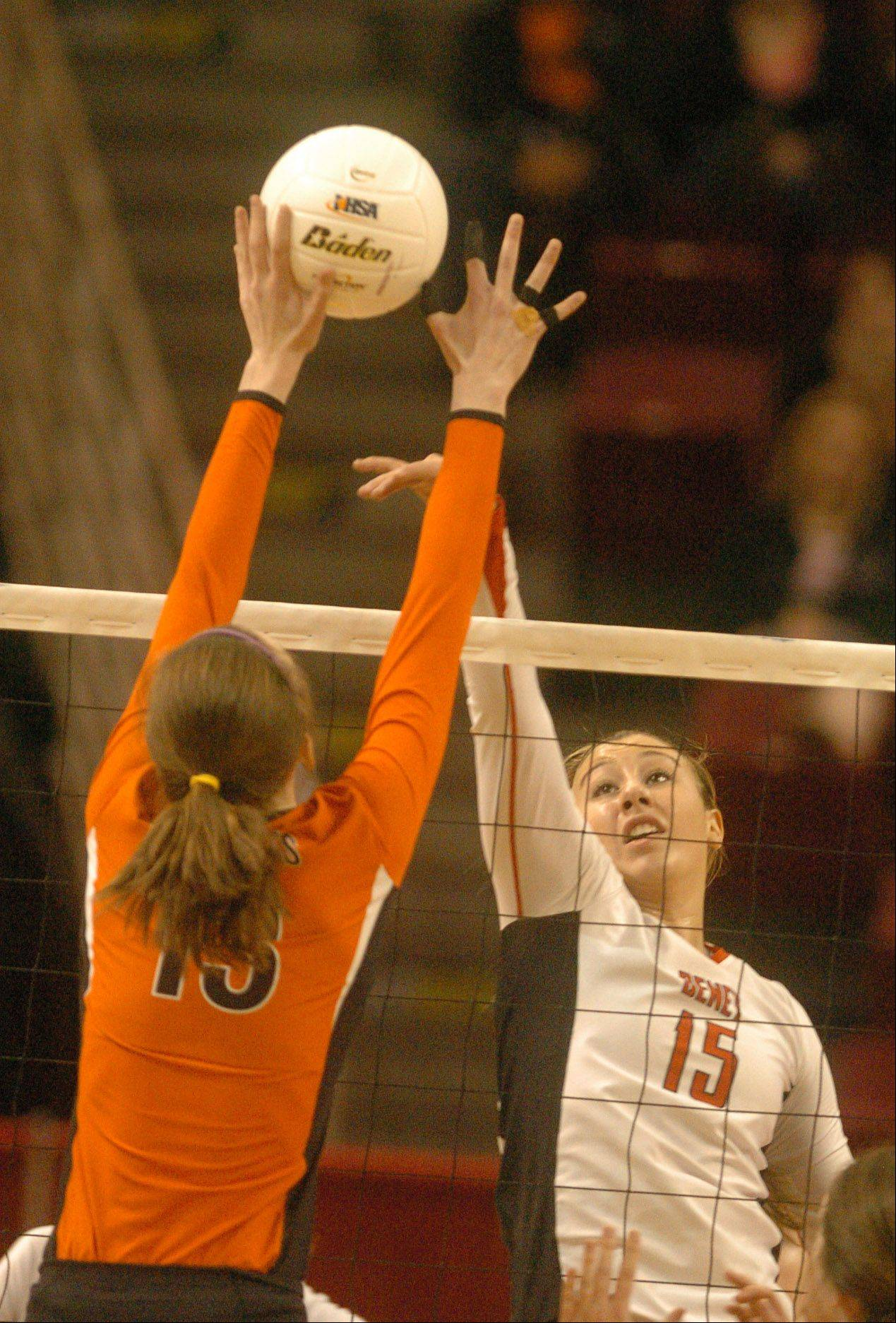 Hannah Kaminsky of Benet hits one while Julia Smagacz of Libertyville tries to block it during the class 4A girls volleyball semifinal, Benet vs. Libertyville at Redbird Arena, on Illinois State campus Friday.