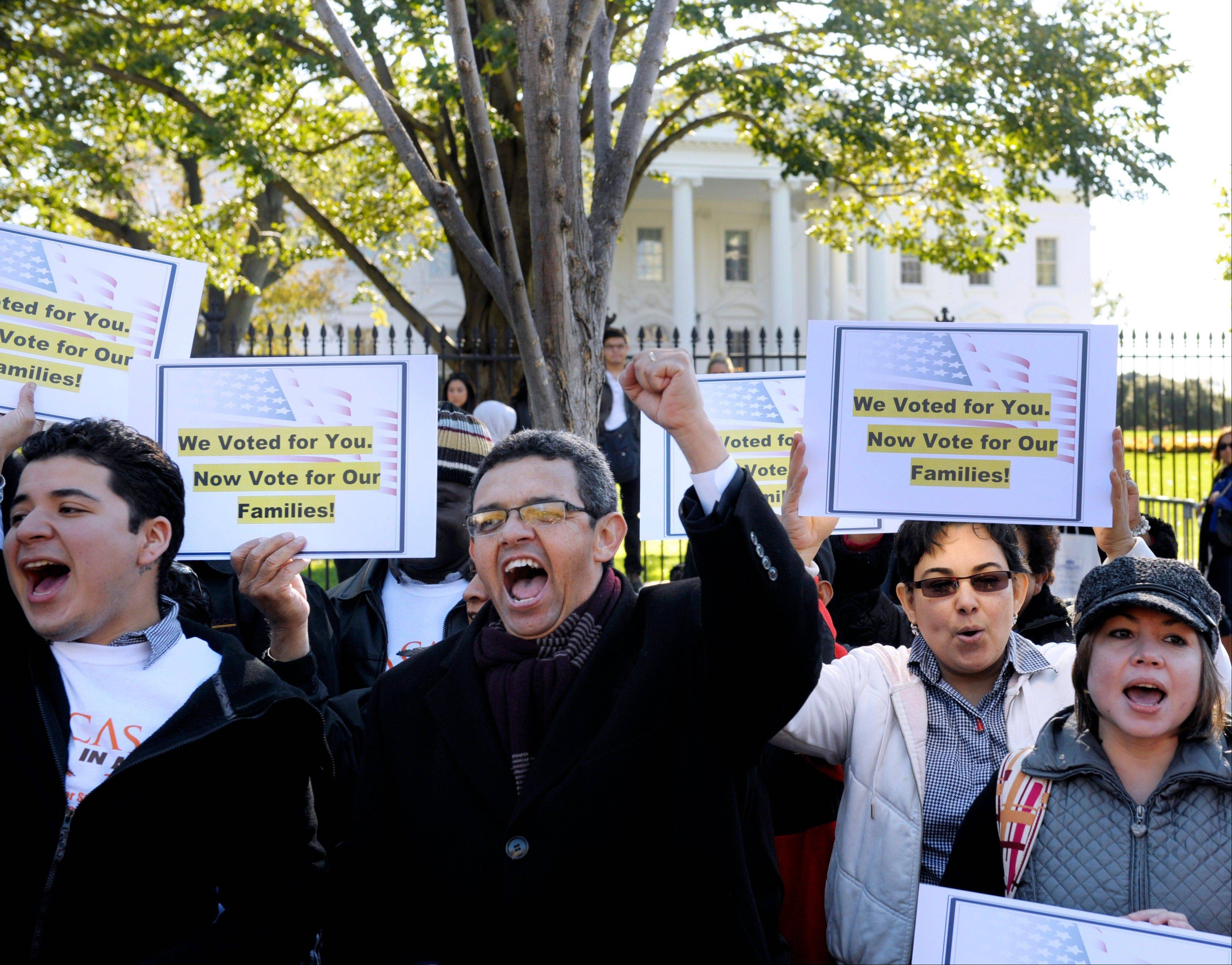 Gustavo Torres, director, Casa in Action, center, and others rally in front of the White House on Thursday, calling on President Barack Obama to fulfill his promise of passing comprehensive immigration reform.