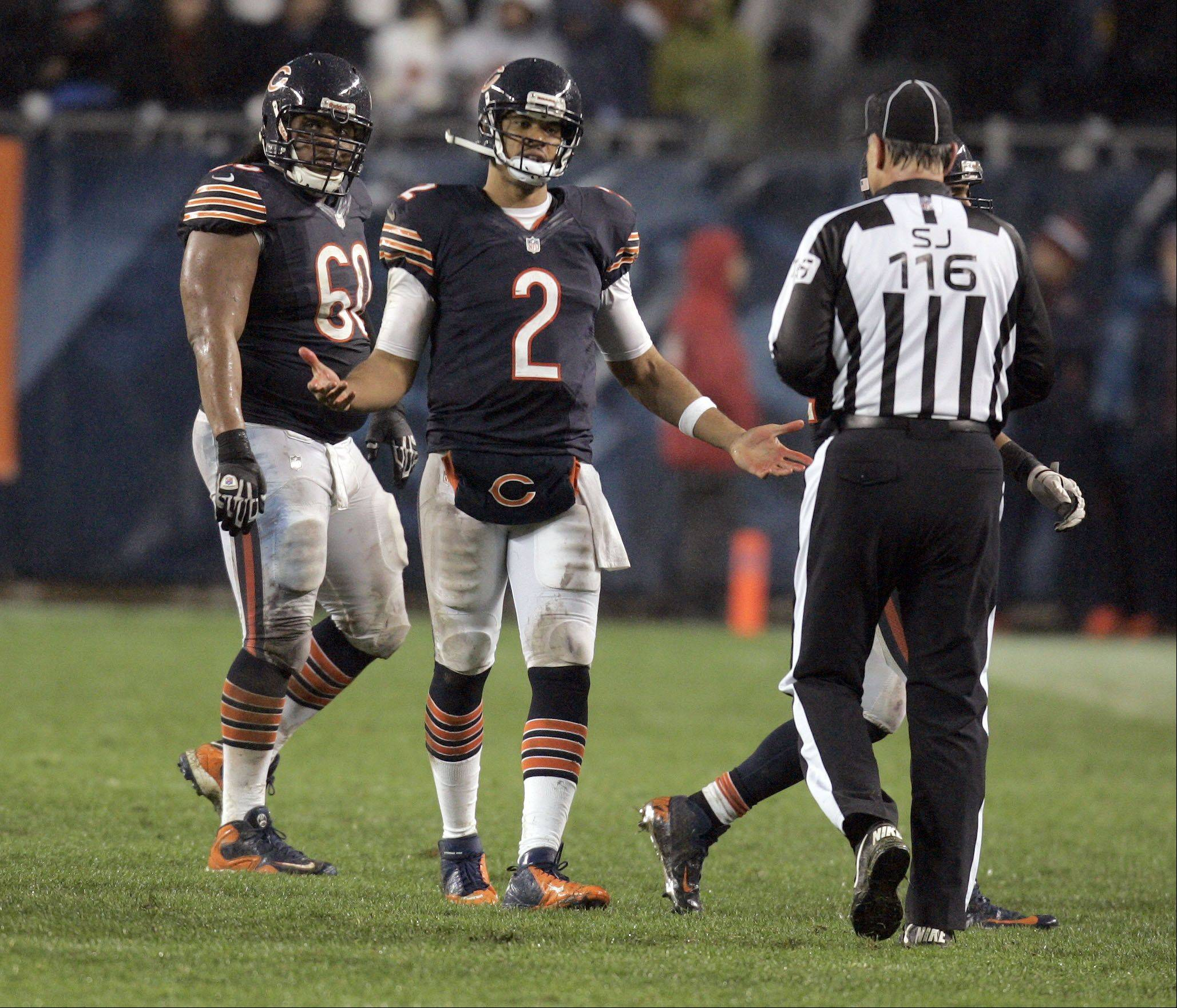 Chicago Bears quarterback Jason Campbell (2) talks to one of the officials late in the fourth quarter during the game.
