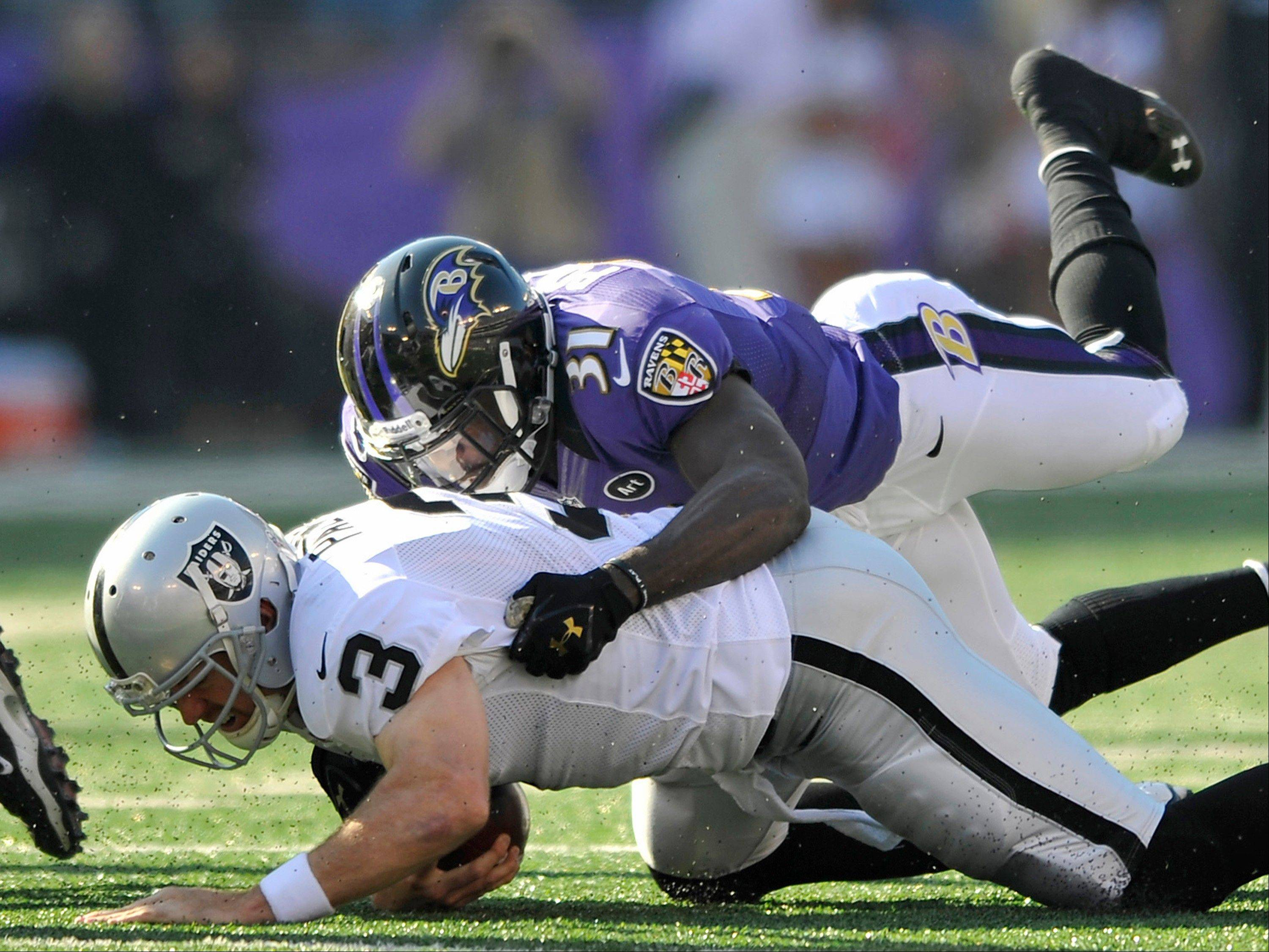 Oakland Raiders quarterback Carson Palmer (3) is sacked by Baltimore Ravens strong safety Bernard Pollard in the first half of an NFL football game in Baltimore, Sunday, Nov. 11, 2012.