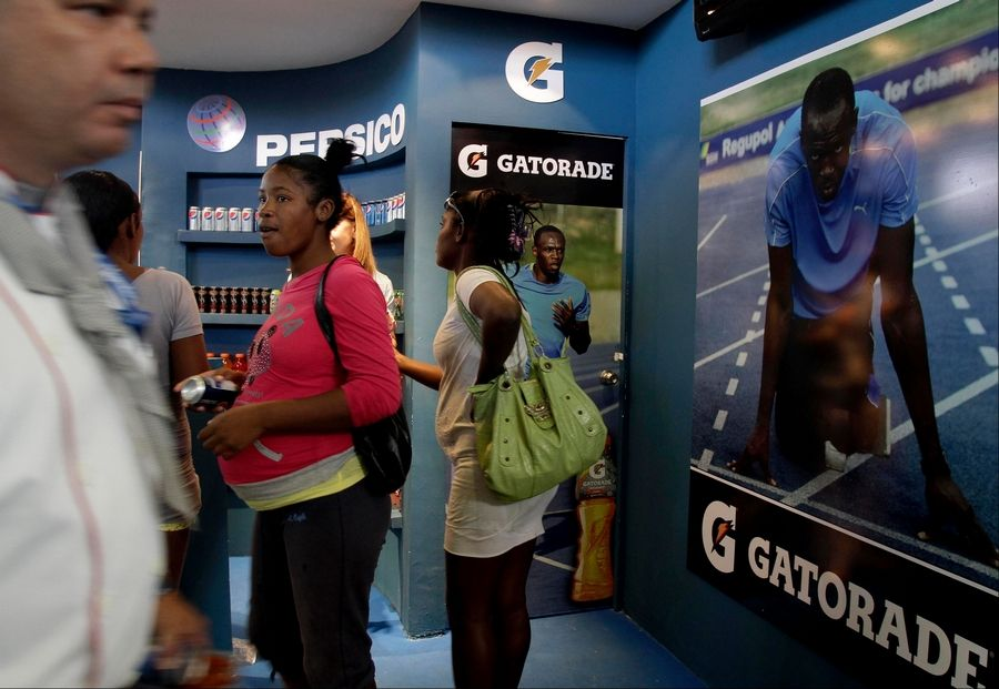 In this picture taken Wednesday Nov. 7, 2012 people visits the Pepsi/Gatorade stand during the 30th Havana International Trade Fair, in Havana, Cuba. Many of America's best-known brands were on display at a Havana exposition center this past week as representatives hawked some of the few U.S. products that can legally be exported to Cuba, thanks to an exception to the U.S. embargo allowing cash-up-front sales of food, agricultural goods and medicine.