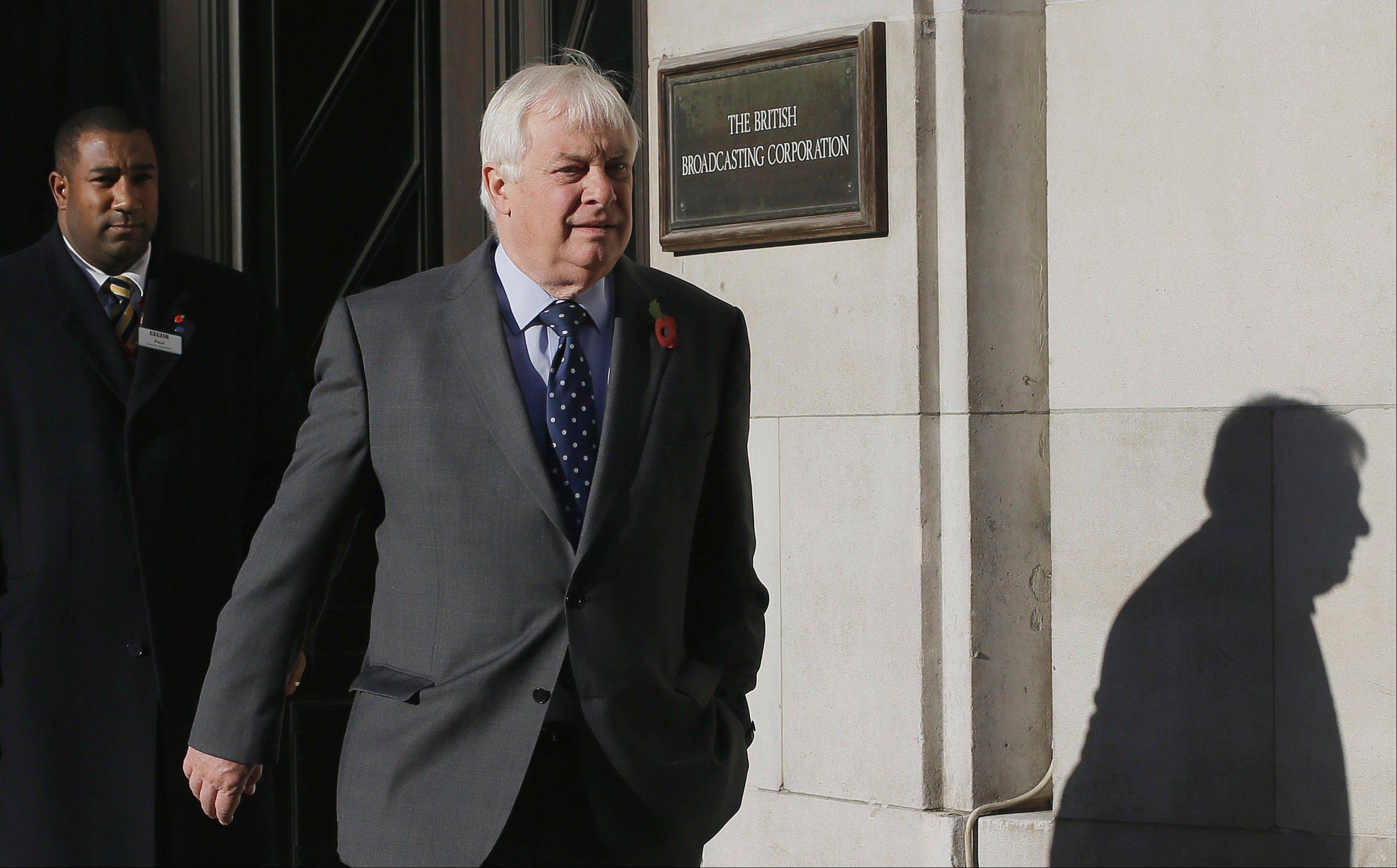 Chris Patten, Chairman of the BBC Trust walks out of the BBC headquarters to give a media interviews in London, Sunday, Nov. 11, 2012. The head of the BBC's governing body said Sunday the broadcaster needs a radical overhaul following the resignation of its chief executive in wake of a scandal over a botched report on child sex-abuse allegations.